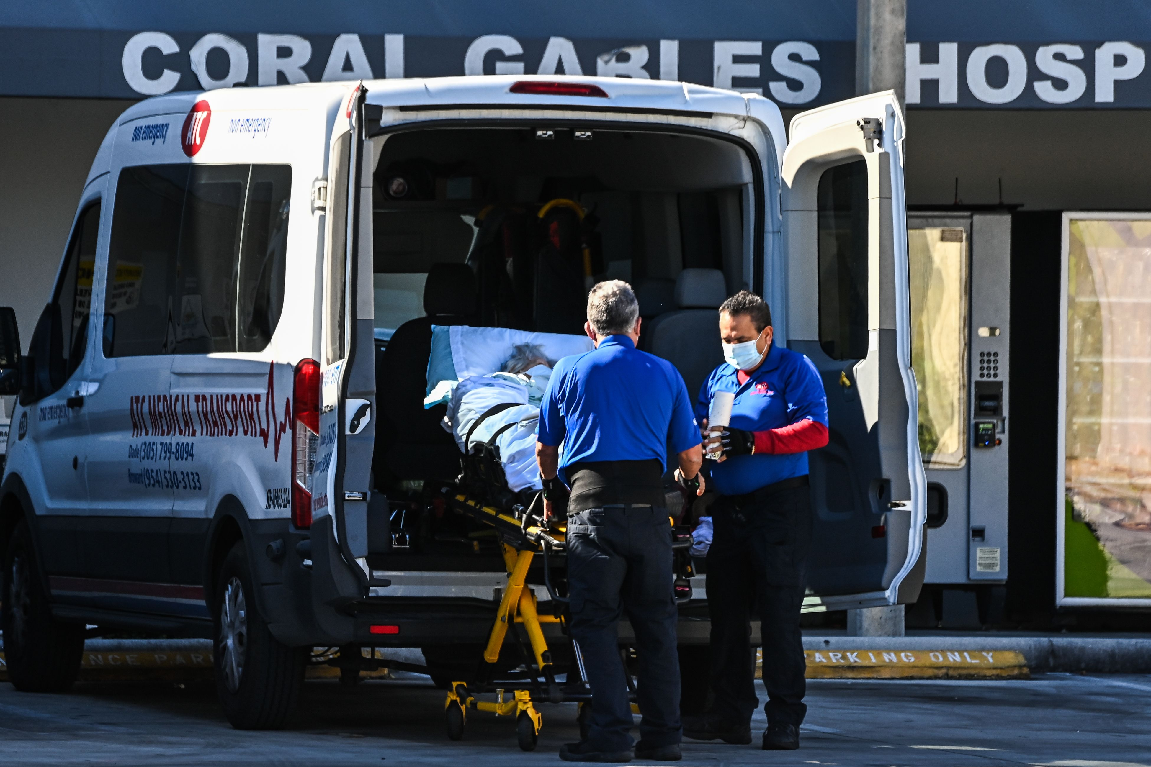 Medics transfer a patient at Coral Gables Hospital where coronavirus patients are treated in Miami, Florida, on December 10.