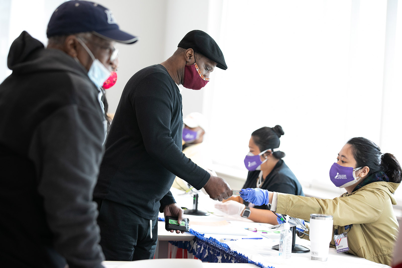 Voters check-in with poll workers to cast their ballots at the Metropolitan Library on November 3, in Atlanta, Georgia.