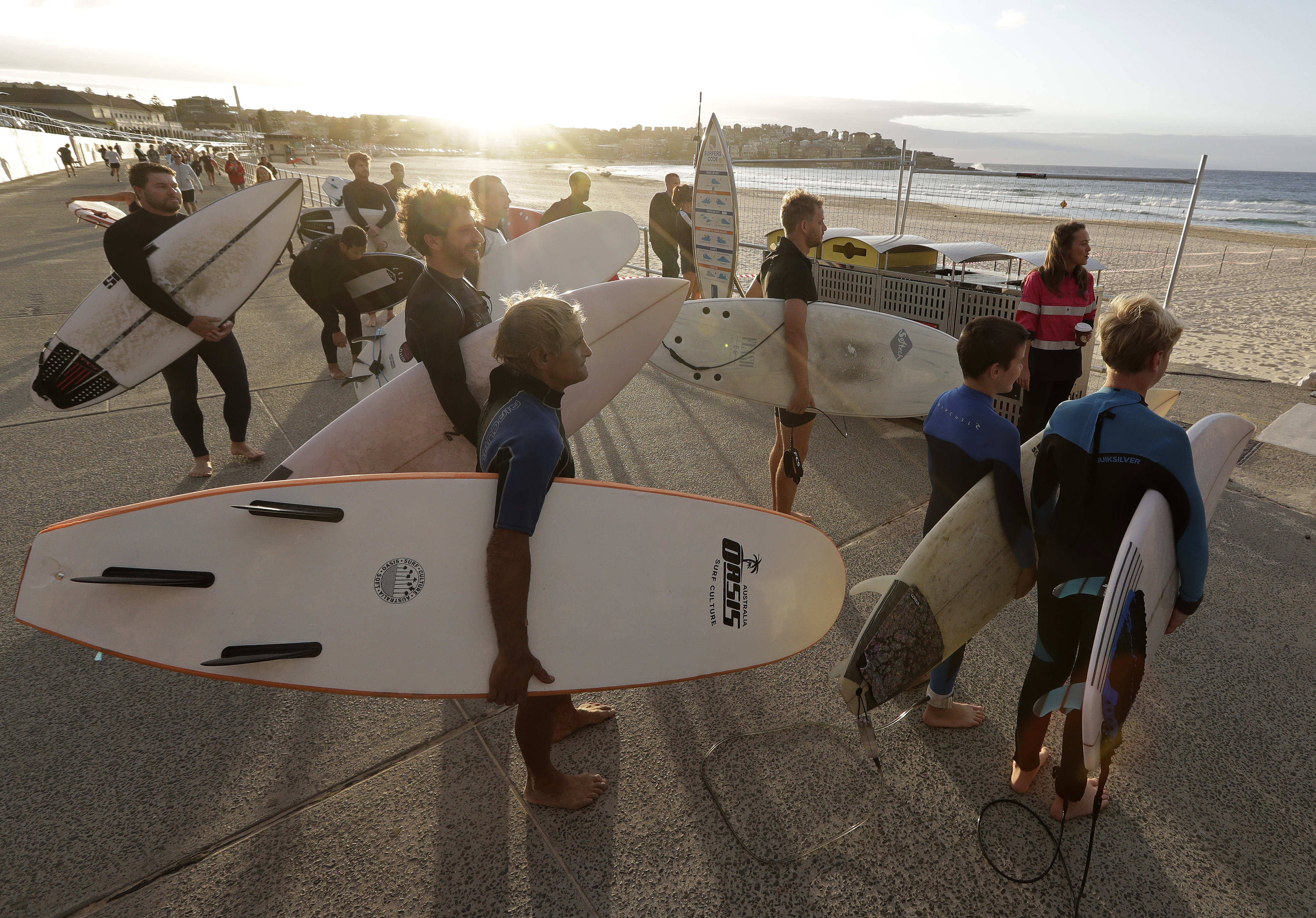Surfers wait for officials to open Bondi Beach in Sydney, Australia, on April 28, as coronavirus pandemic restrictions are eased.