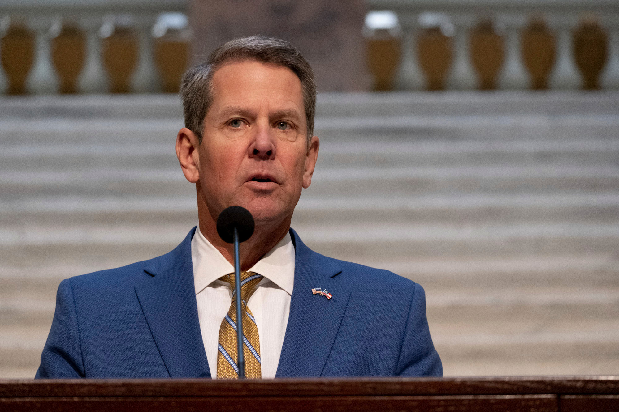 Georgia Gov. Brian Kemp holds a news conference on November 24 at the Georgia State Capitol in Atlanta.