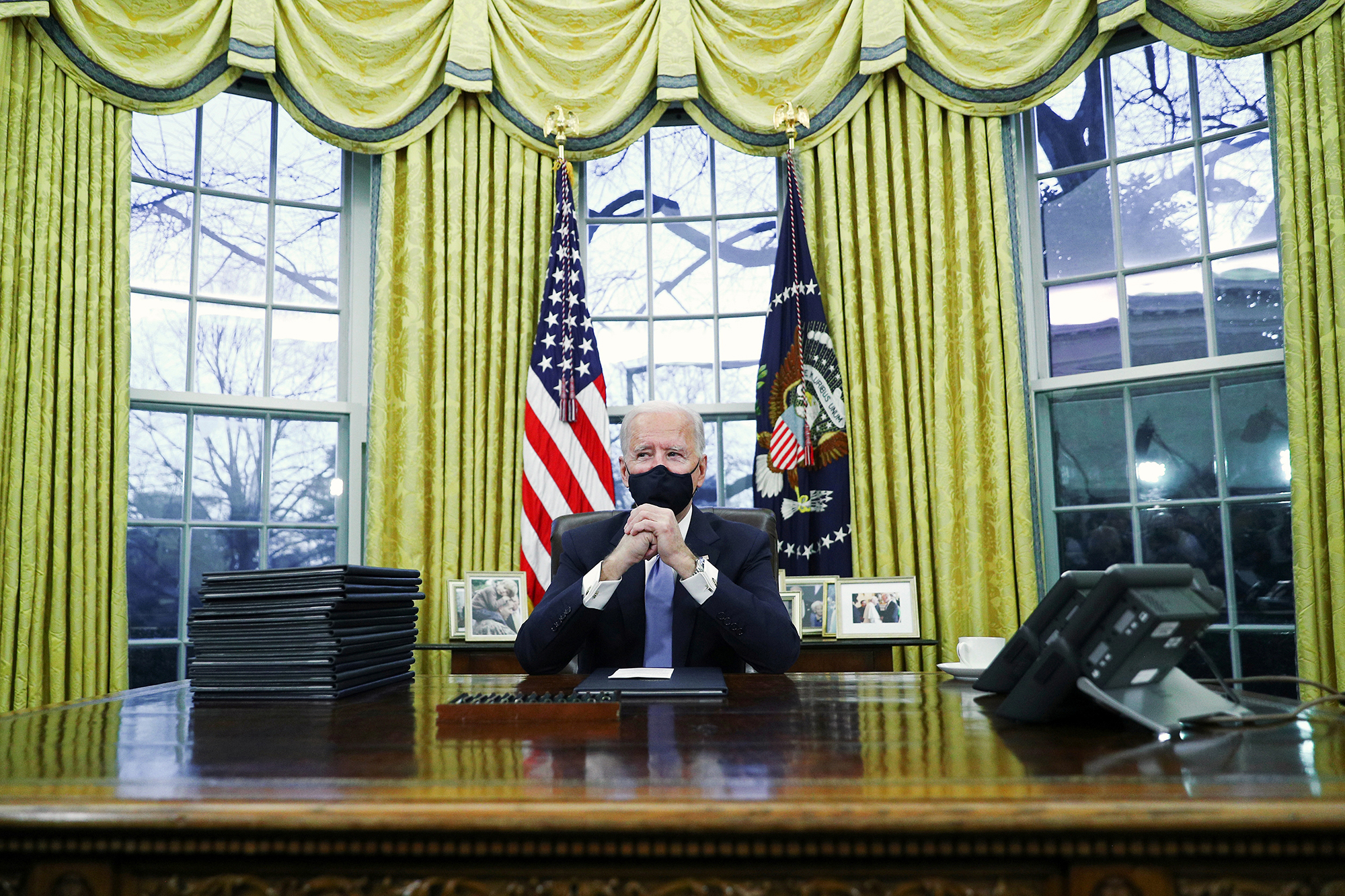 President Joe Bidensigns executive ordersin the Oval Office after his inauguration on January 20.