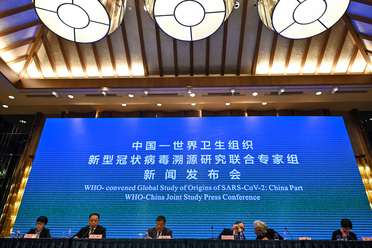 World Health Organization experts attend a news conference with Chinese health officials in Wuhan on February 9, 2021.