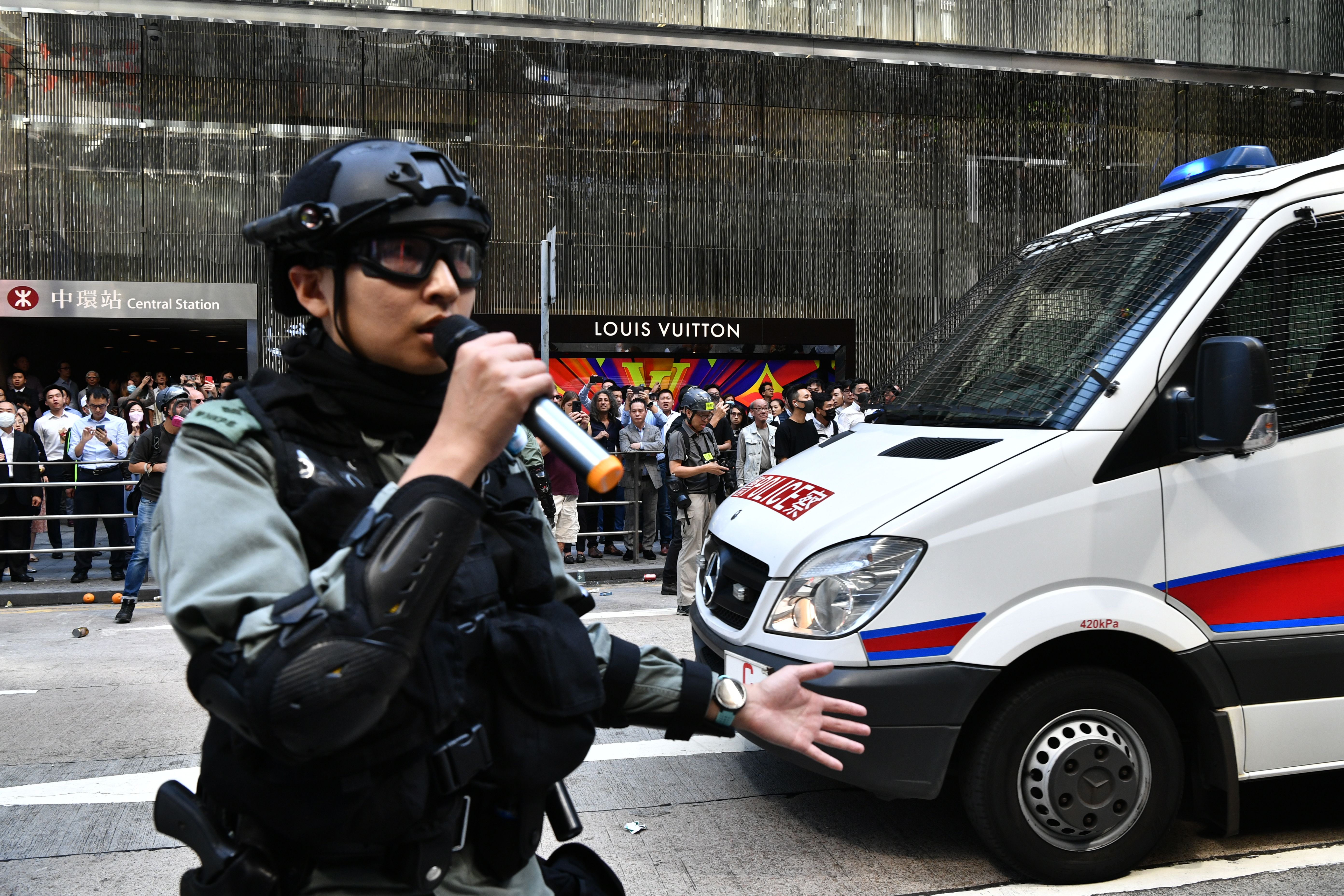 A police officer addresses protesters in Hong Kong on November 11, 2019.
