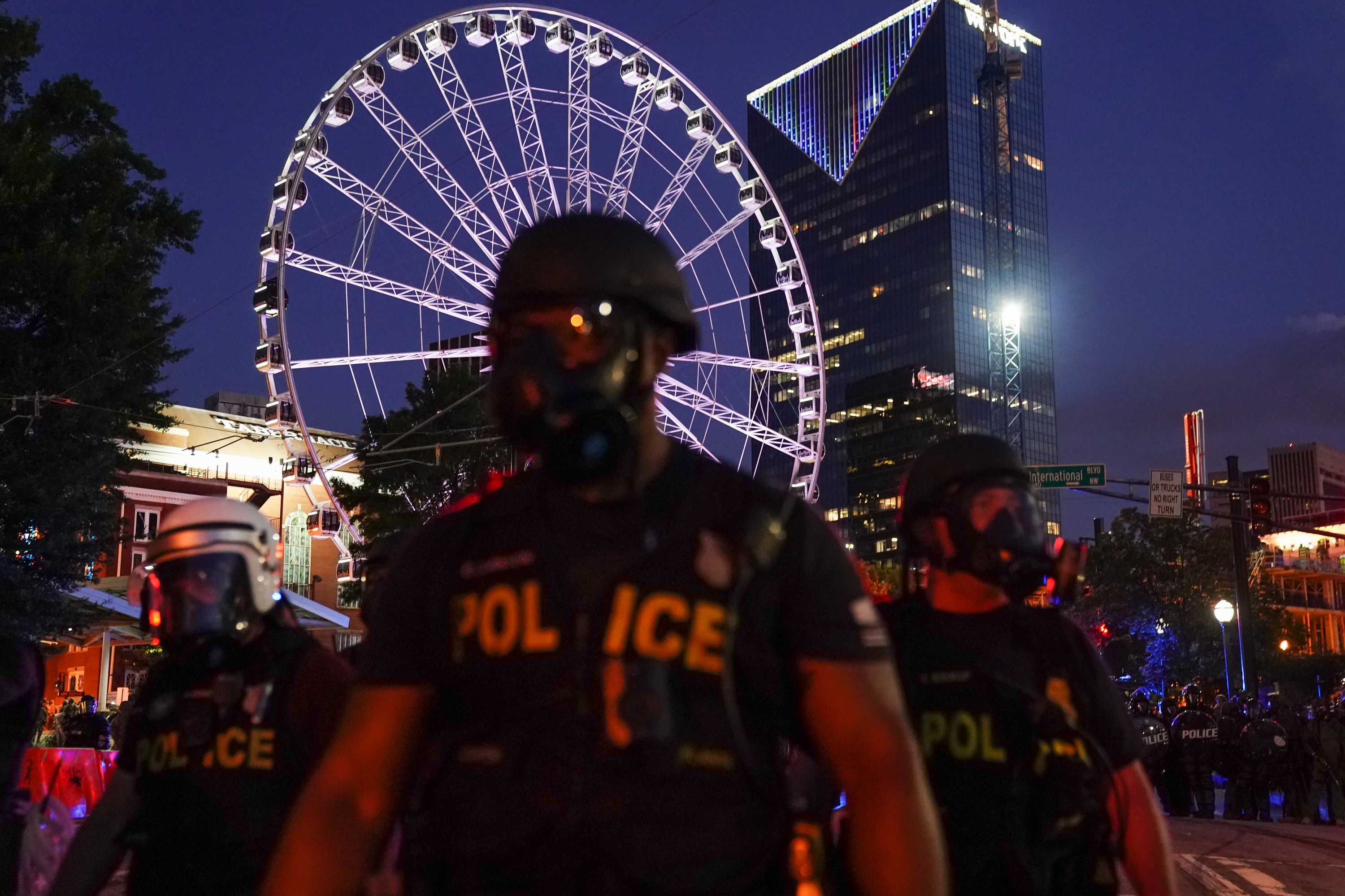 Police officers are seen during a demonstration in Atlanta on Sunday, May 31.