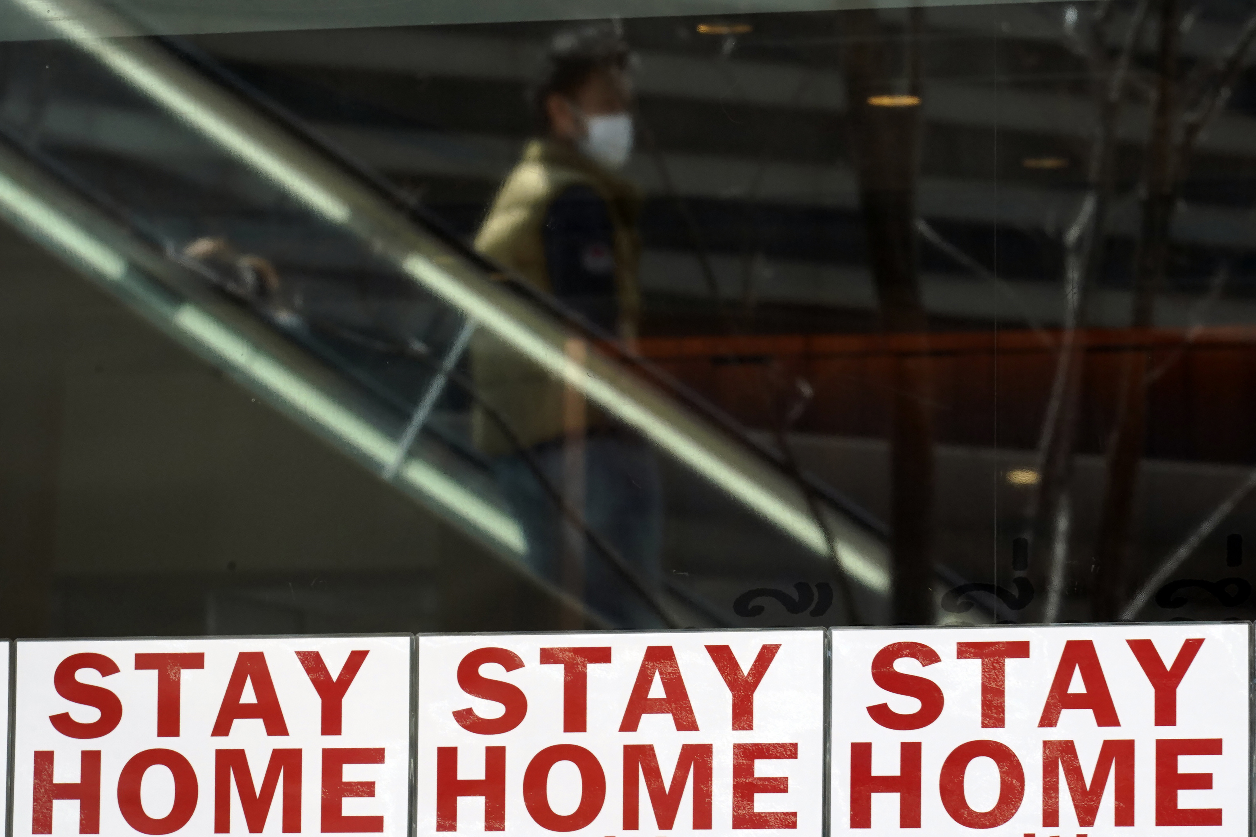 Signs urge people to stay home to help stop the spread of the novel coronavirus in Tokyo, Japan, on April 10.