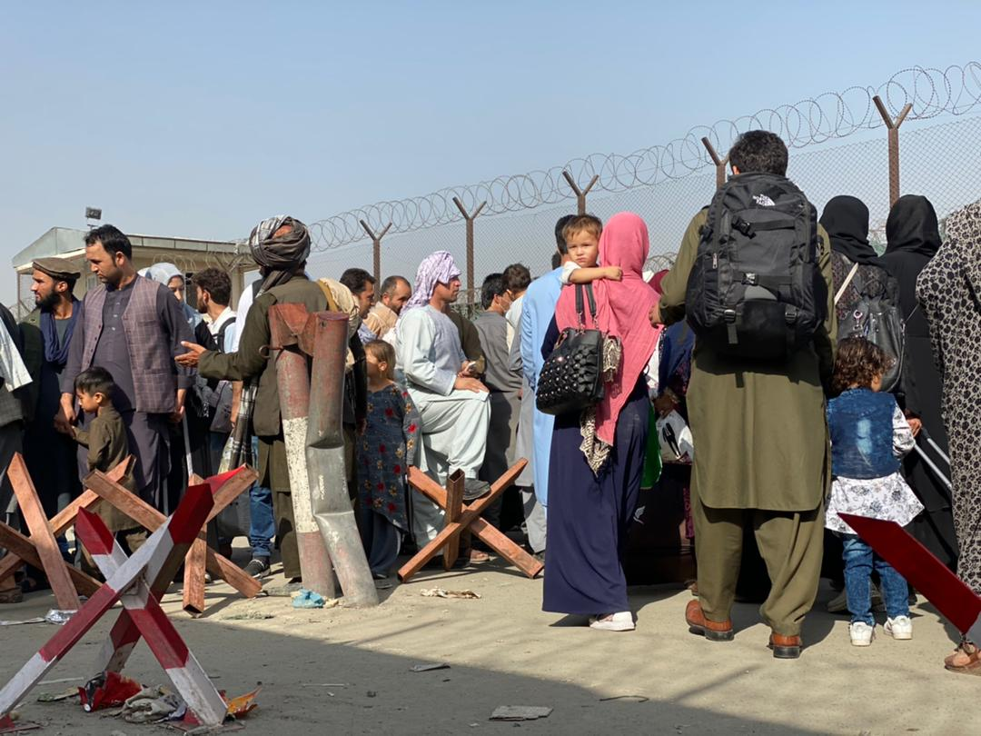 Crowds of Afghan civilians and their families in Kabul, Afghanistan, on August 19.