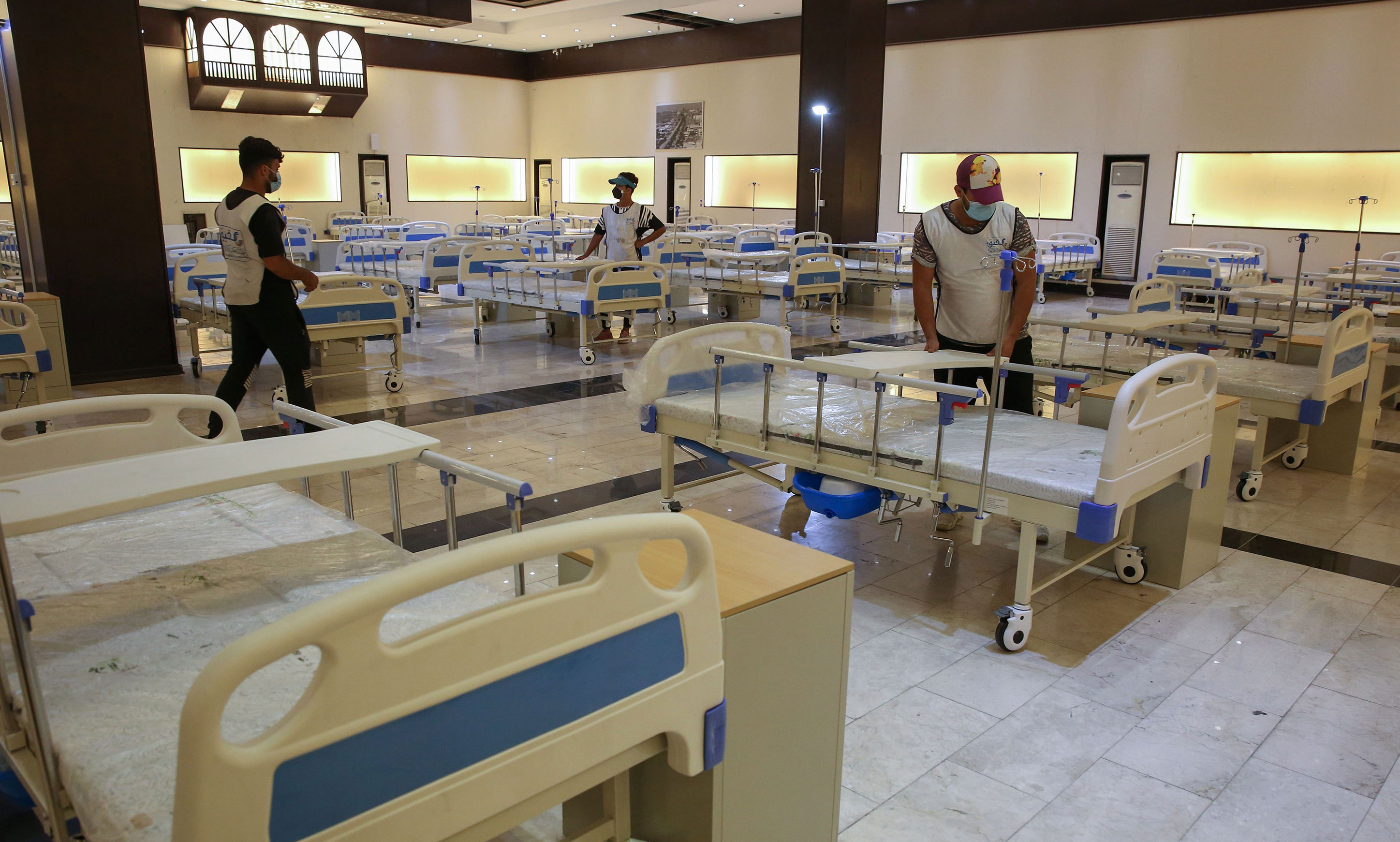 Volunteers set up a field hospital for coronavirus patients on June 21 in Baghdad, Iraq.