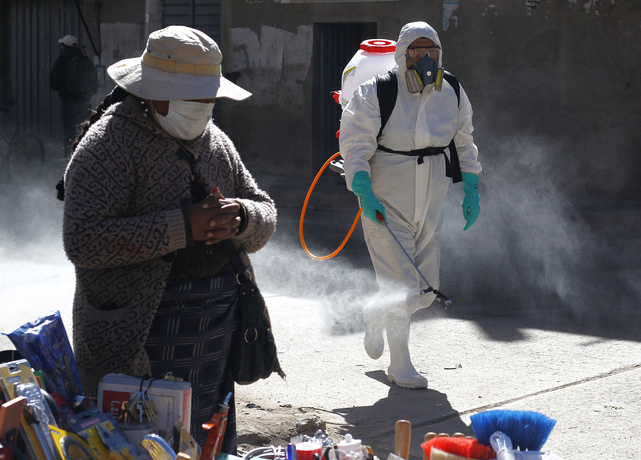A municipal worker sprays disinfectant at a market on June 10 in Puno, Peru.