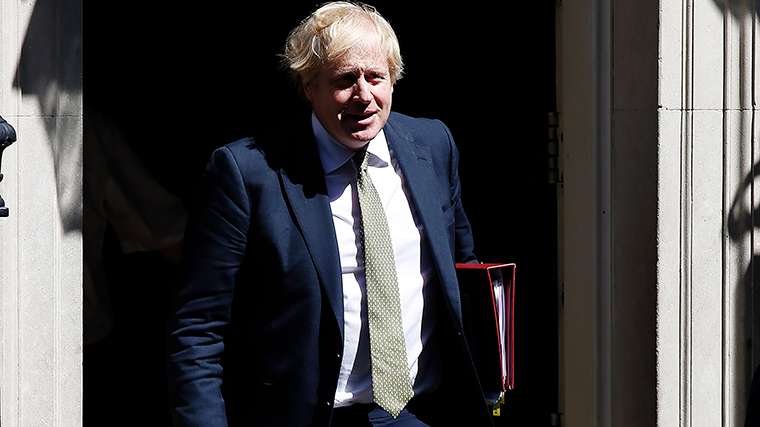 UK Prime Minister Boris Johnson leaves Downing Street to attend Prime Minister's Questions, his first since recovering from Covid-19, at the House of Commons on May 6, 2020 in London.