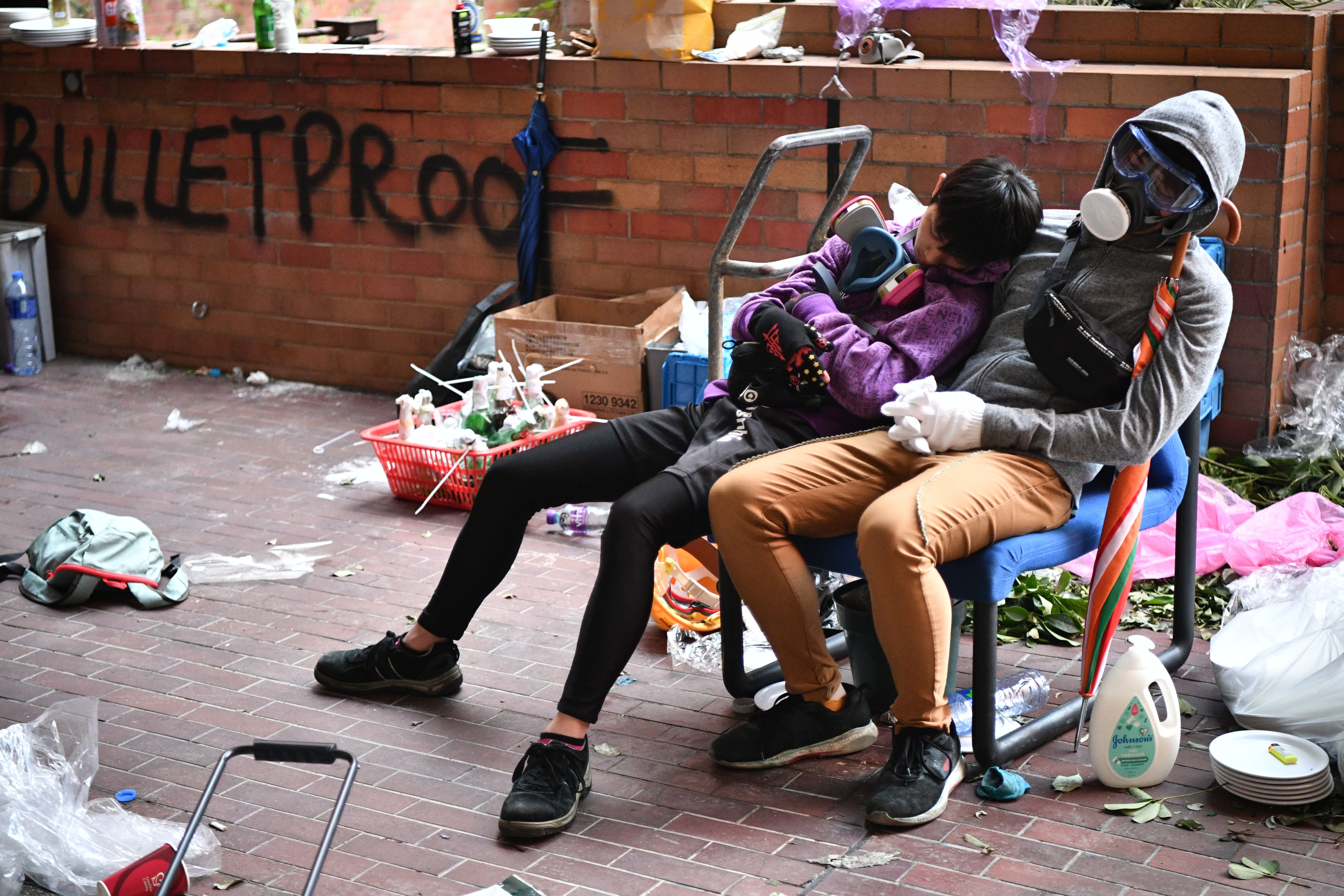 Protesters rest during a lull in clashes at the Hong Kong Polytechnic University in Hung Hom district of Hong Kong on November 18.
