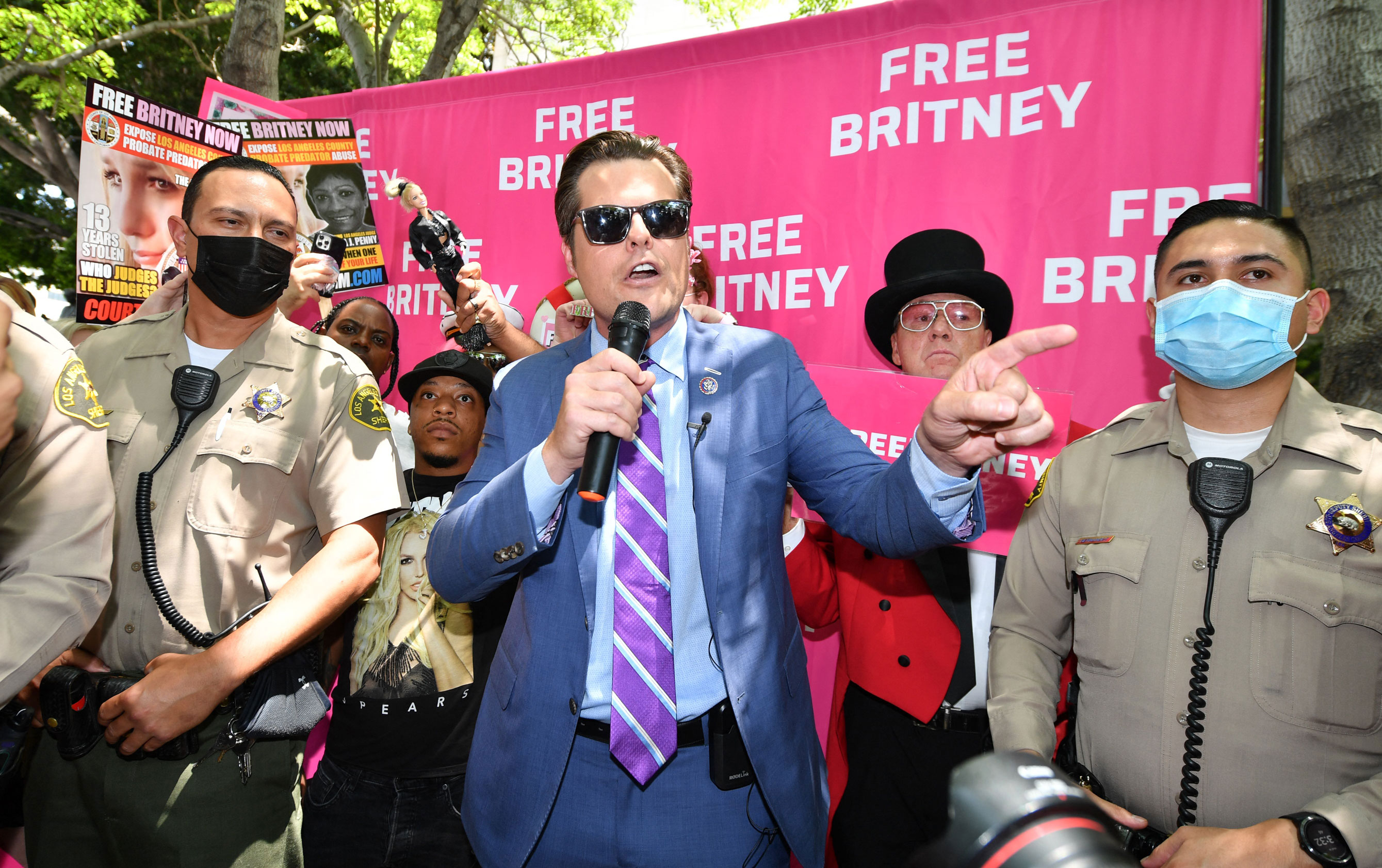 Police officers basal   adjacent  to US Representative Matt Gaetz arsenic  helium  speaks to fans and supporters of Britney Spears gathered extracurricular  the Los Angeles County Courthouse successful  Los Angeles, connected  Wednesday, July 14, during a scheduled proceeding  successful  the Britney Spears guardianship case.