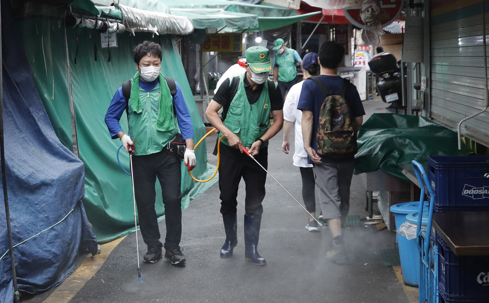 People disinfect as a precaution against the coronavirus at a local market in Seoul, South Korea, on Wednesday, September 2.