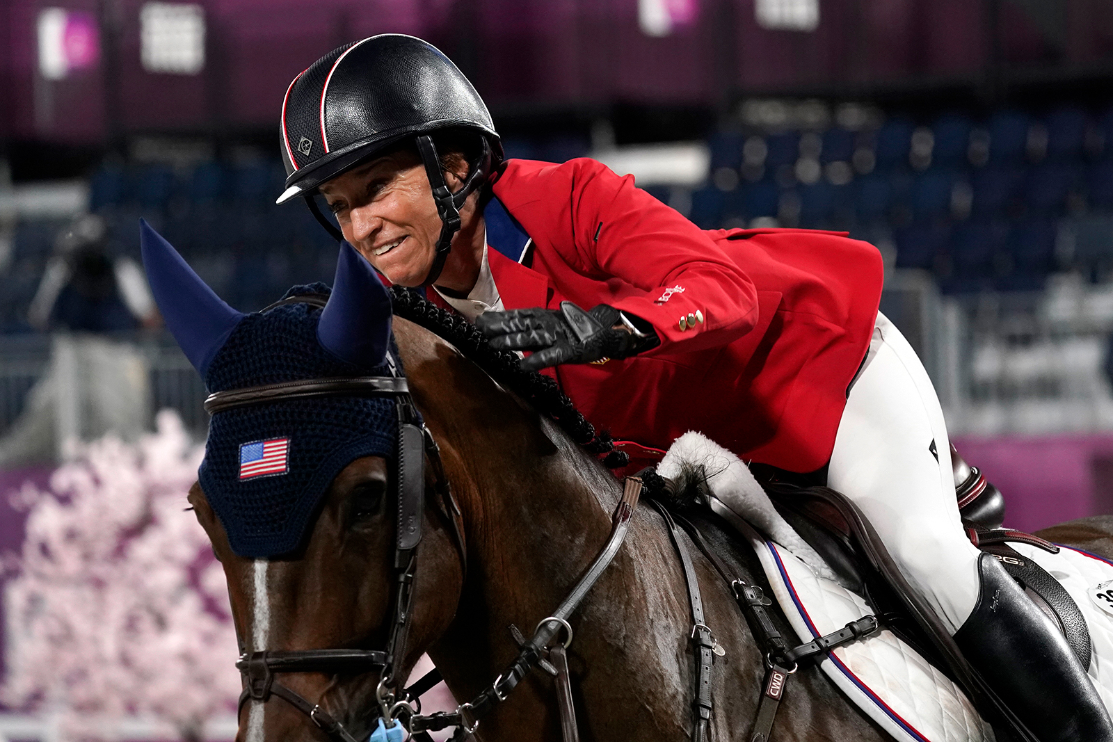 United States' Laura Kraut, riding Baloutinue, celebrates after a jump-off during the equestrian jumping team final at Equestrian Park in Tokyo at the 2020 Summer Olympics, on August 7, in Tokyo.