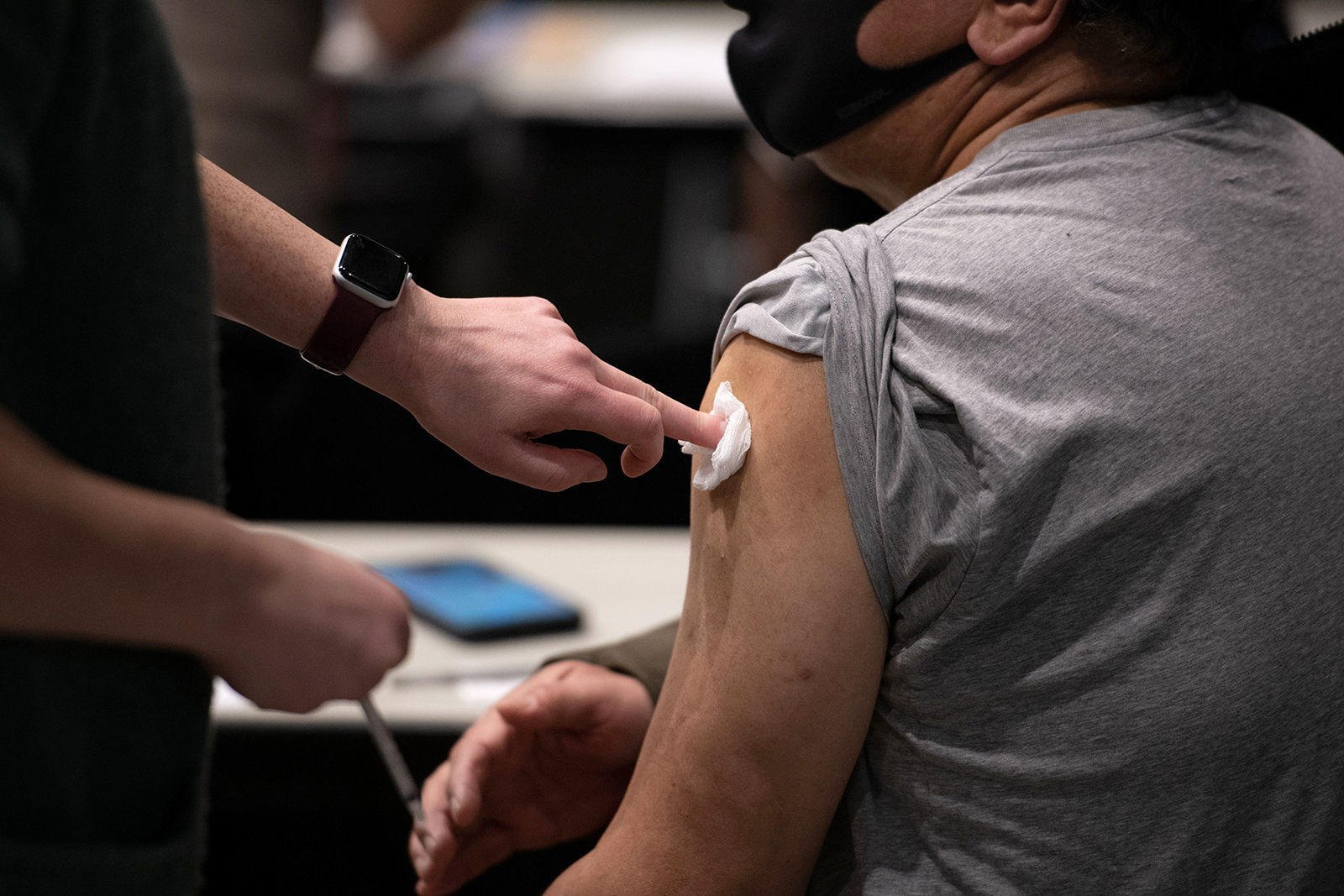 A patient's blood is blotted after receiving a dose of the Pfizer Covid-19 vaccine at Virginia Mason's vaccine clinic in Seattle, Washington on January 24.