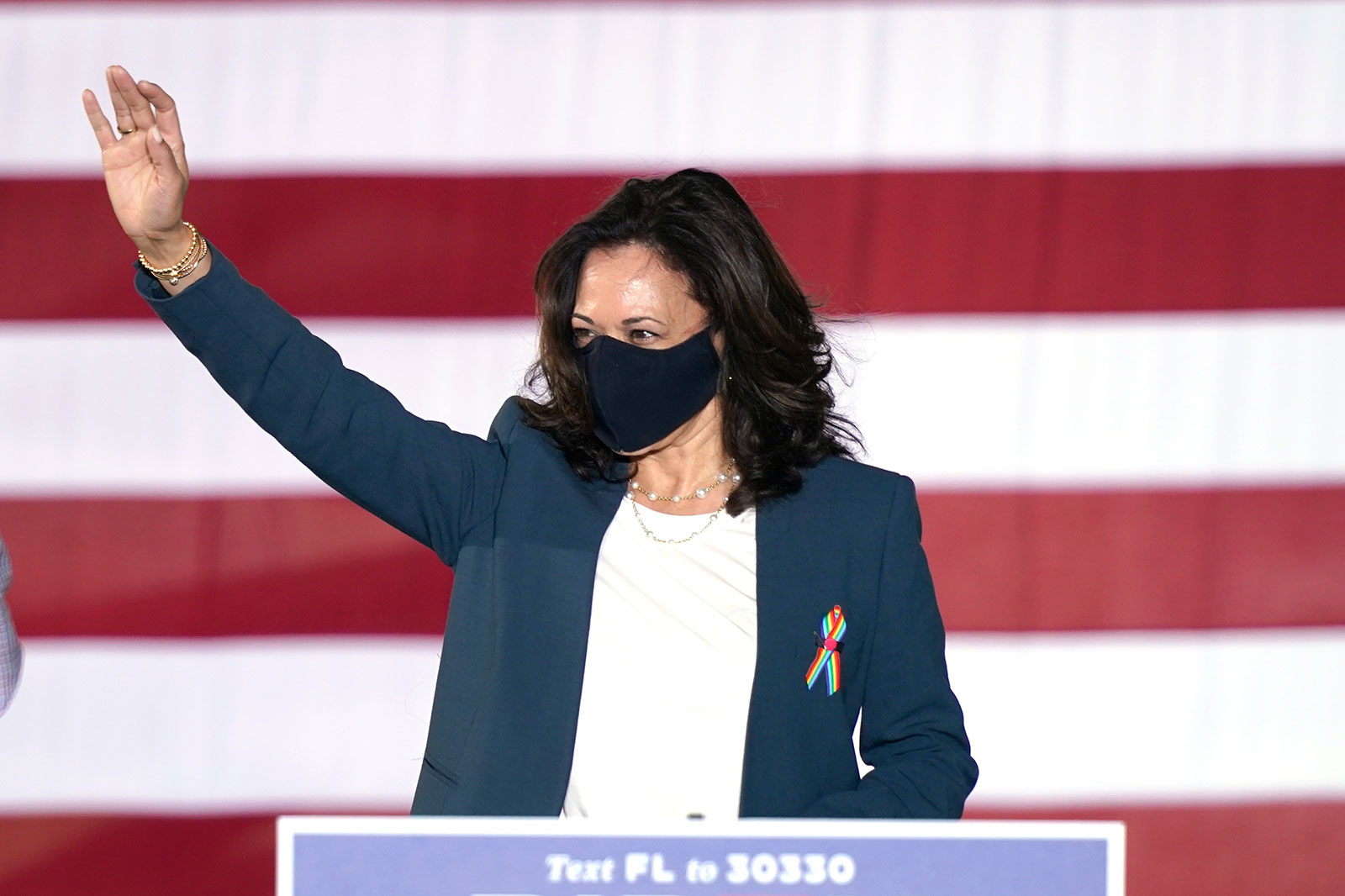 Sen. Kamala Harris waves to supporters during a campaign event in Orlando, Florida, on October 19.