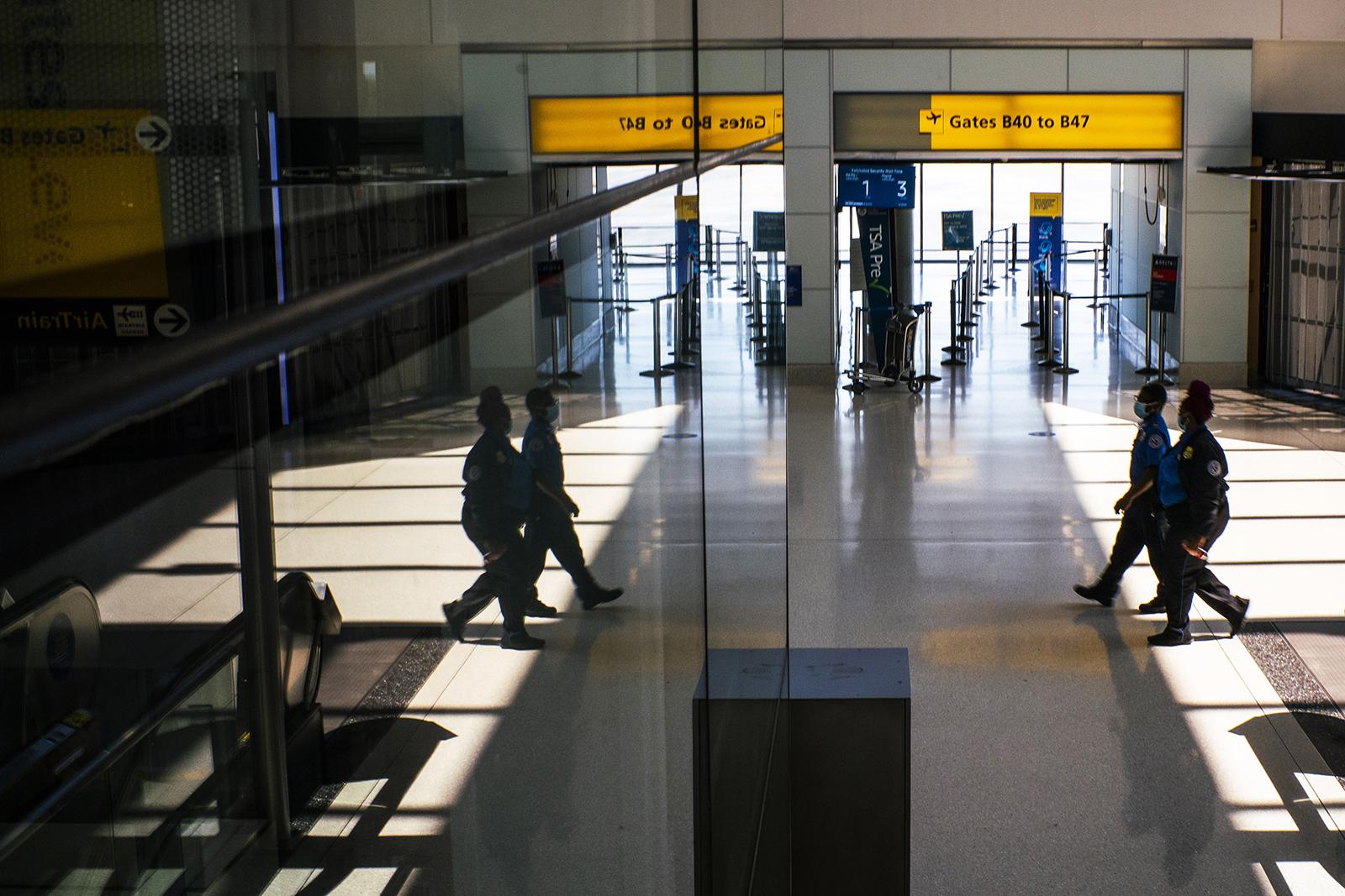 TSA staff work at Newark Liberty International Airport Terminal B on September 8, in Newark, New Jersey.