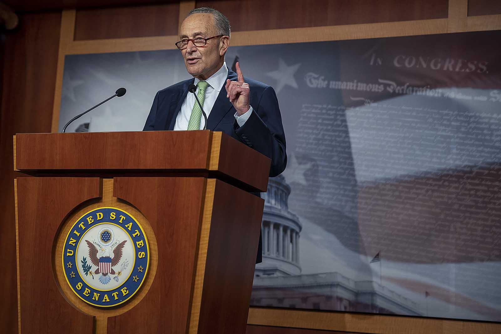 Senate Minority Leader Sen. Chuck Schumer speaks at a news conference on October 1, in Washington.