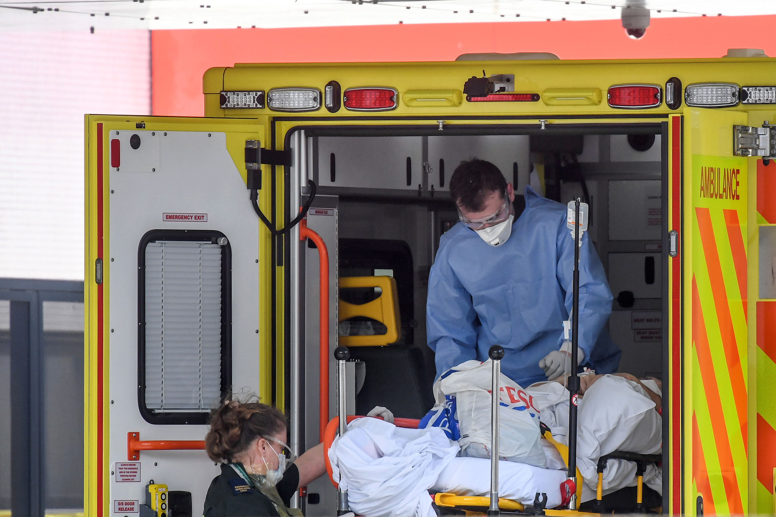 Doctors unload a patient outside St. Thomas' Hospital in London, on April 7.