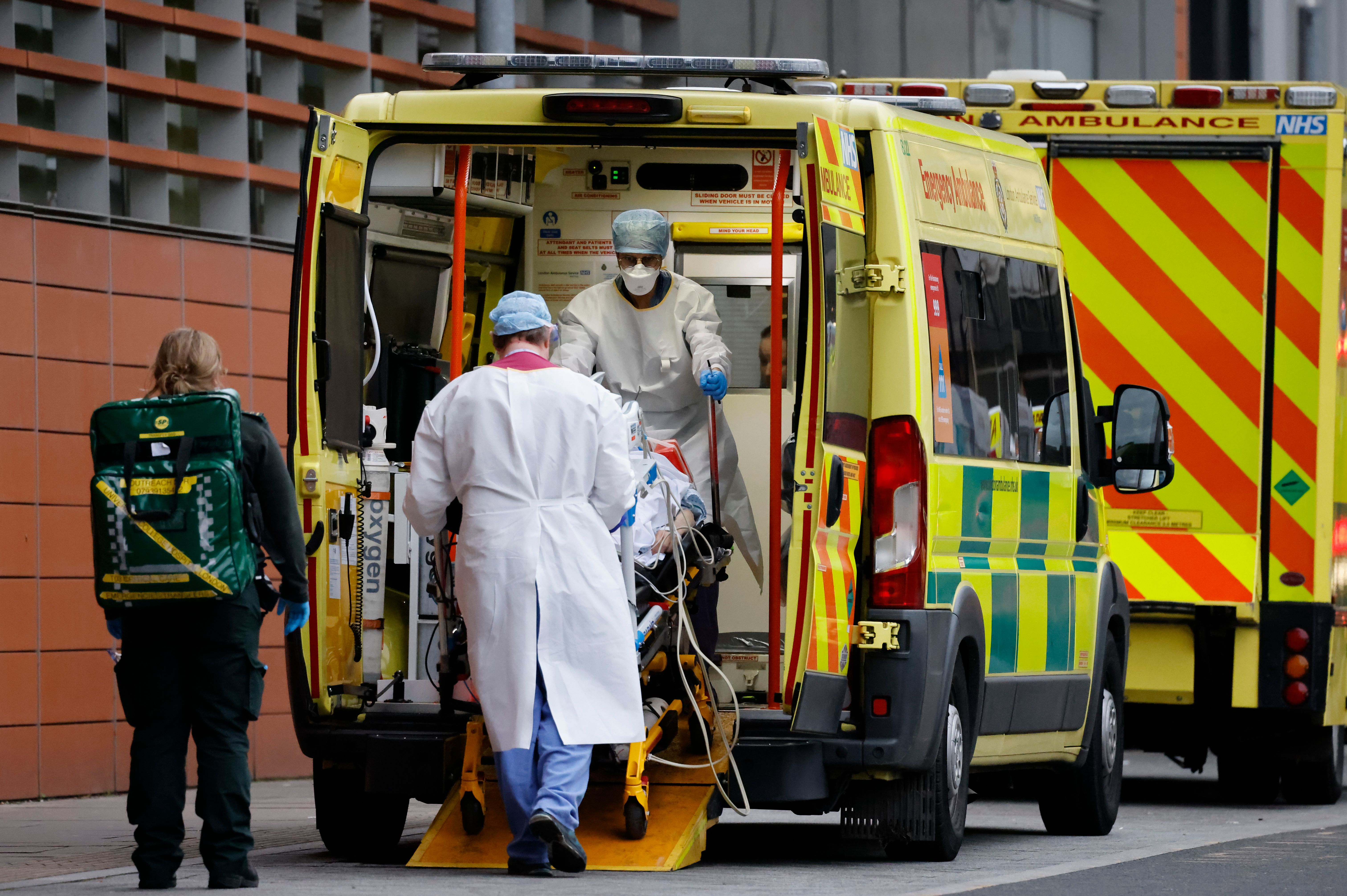 Medics take a patient from an ambulance into a London hospital on Tuesday.