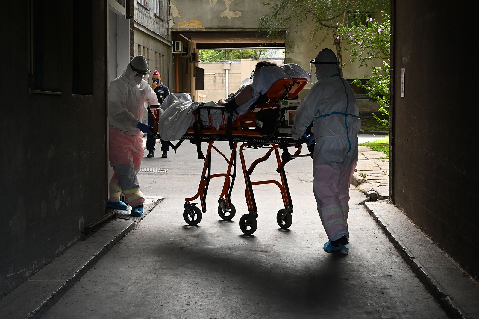 Participants of an exercise wear protective suits as they transport a presumed Covid-19 patient to the Kutvolgyi hospital in Budapest, Hungary, on August 27.