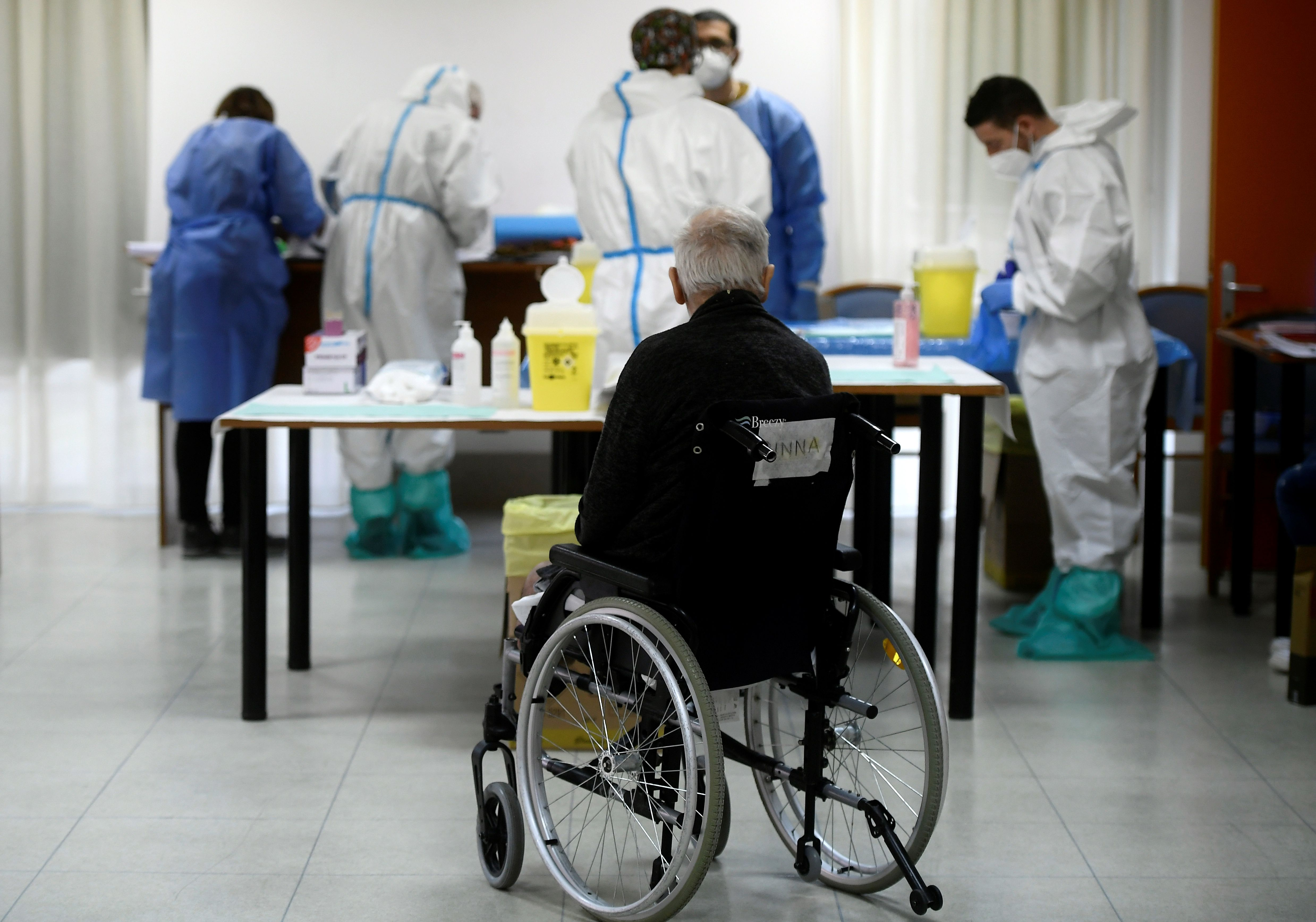 A resident of a care home in Rome waits to receive a dose of the Pfizer-BioNTech COVID-19 vaccine on January 8.