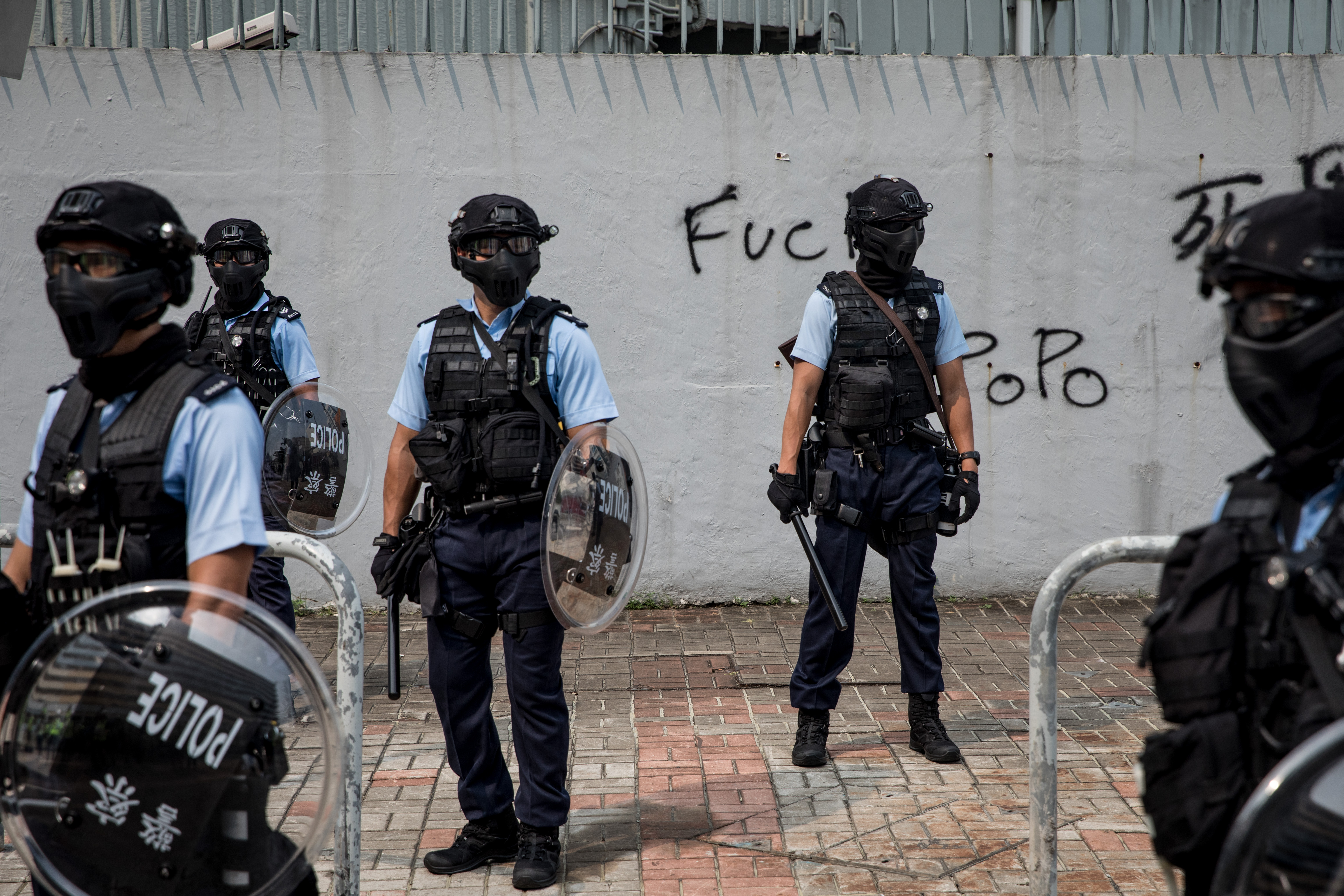Police stand guard in front of a police station on August 24, 2019 in Hong Kong.