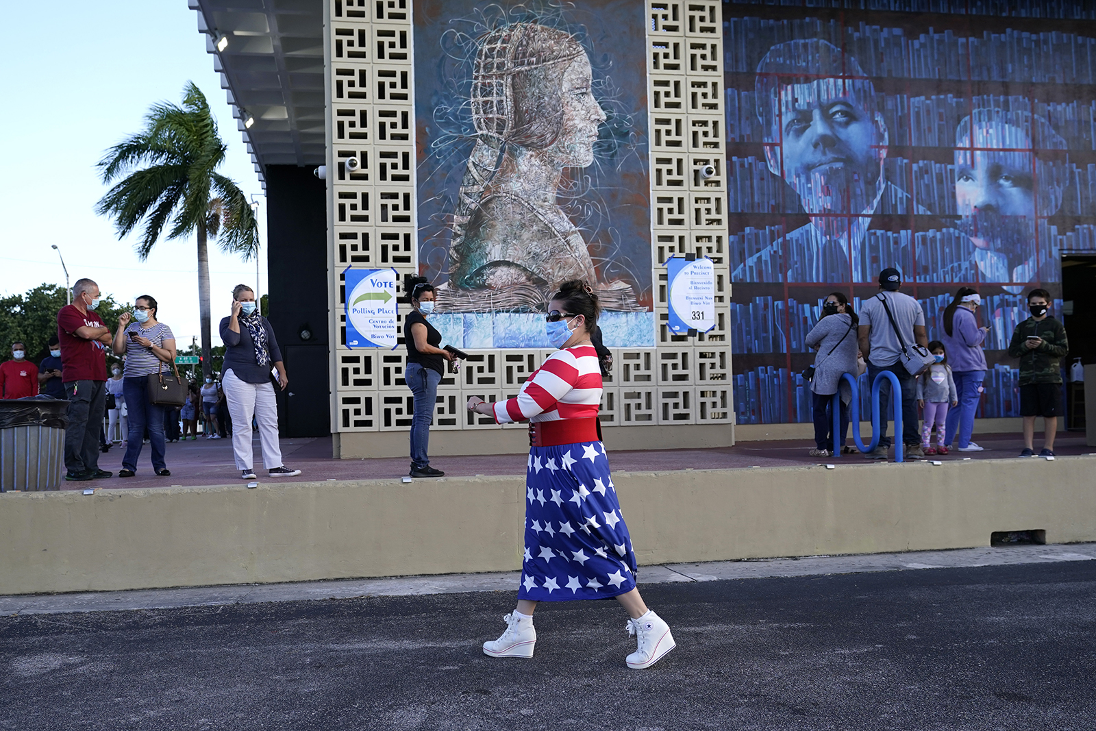 Yanitza Martinez wears red, white, and blue as she arrives to vote outside of the John F. Kennedy Library during the general election on Tuesday in Hialeah, Florida.