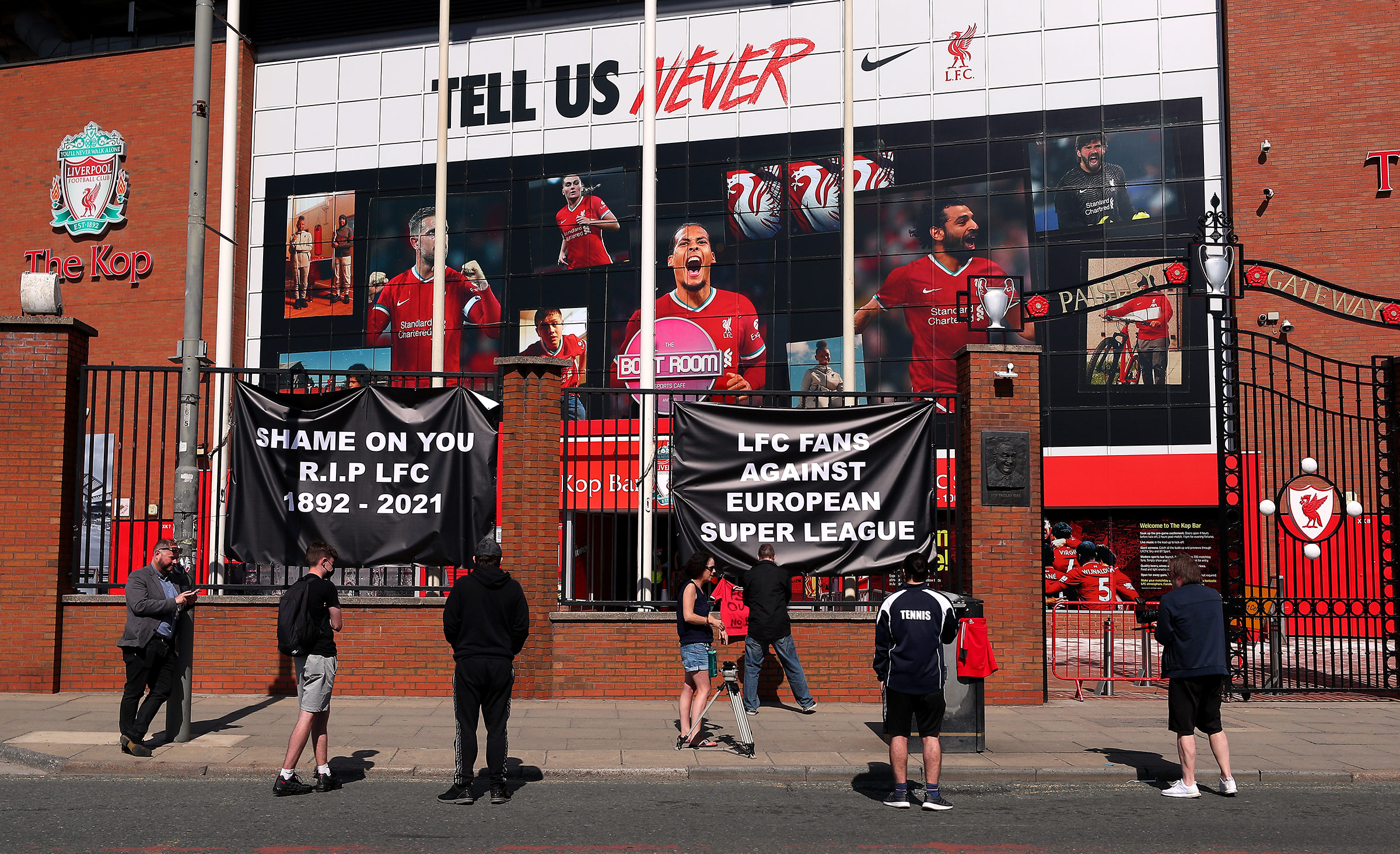 Banners are placed outside of Anfield, home of Liverpool FC, by fans to protest against the team's decision to join the European Super League.