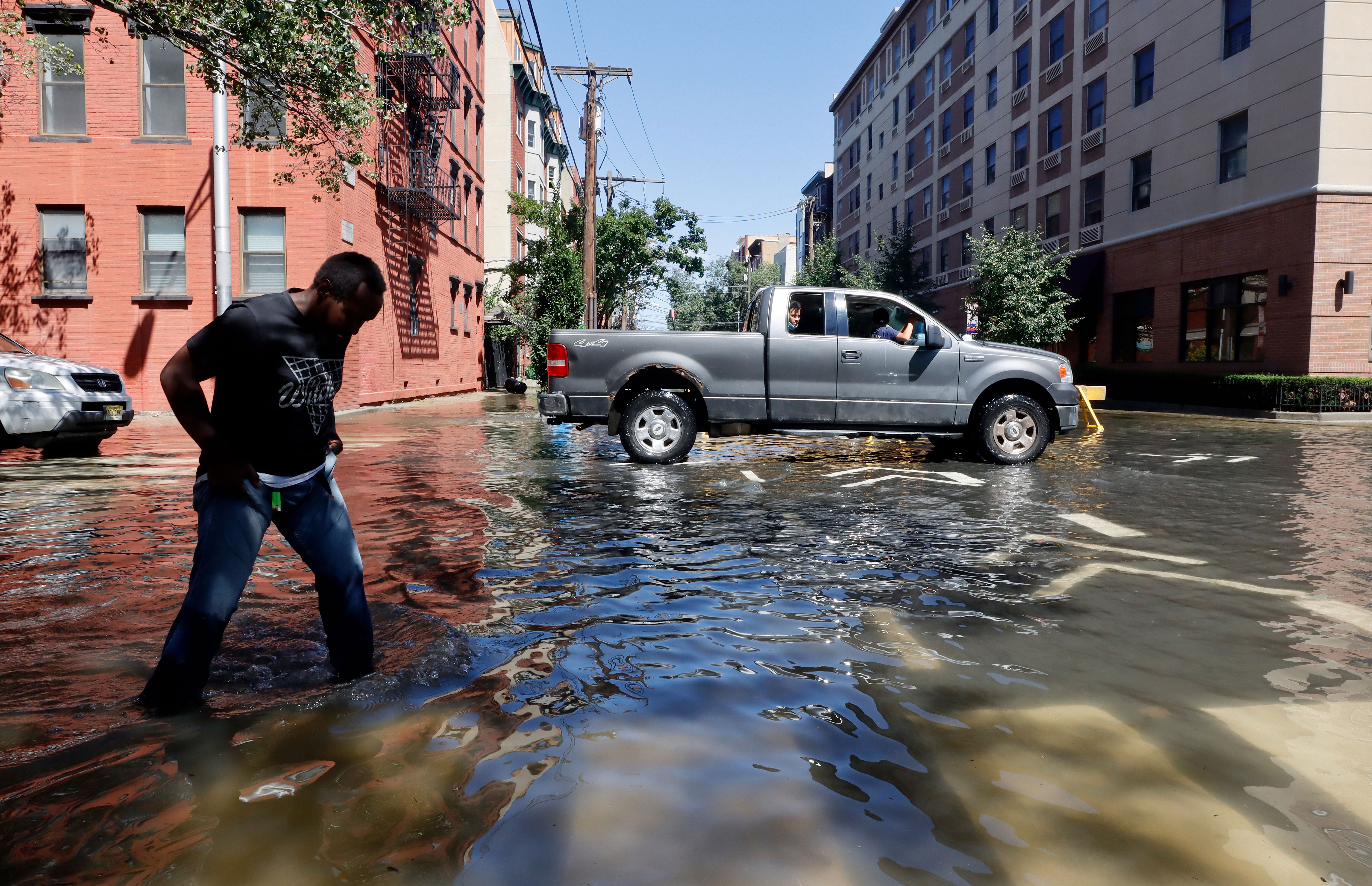 People move through a flooded street in Hoboken, New Jersey, on September 2.