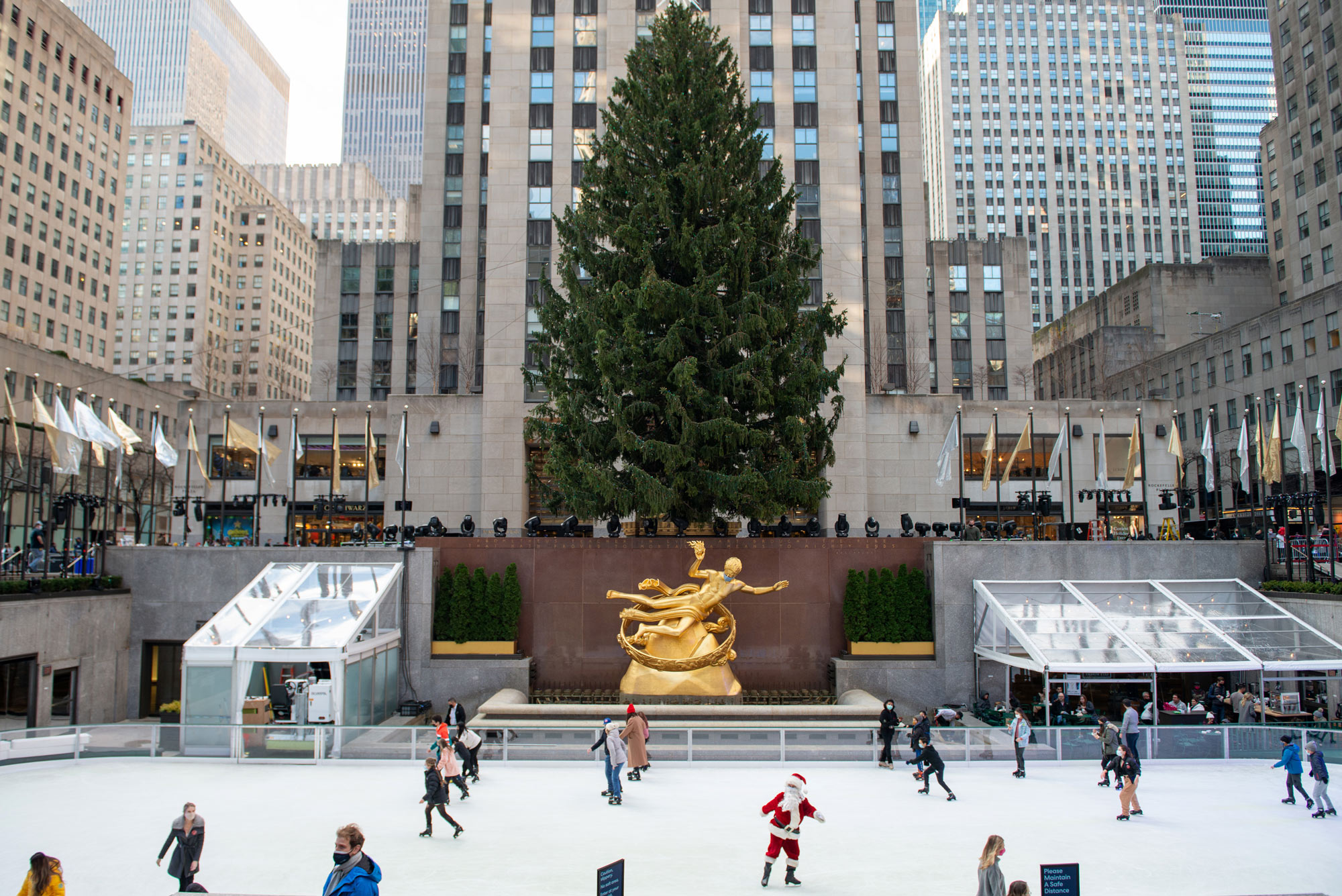 People skate at The Rink at Rockefeller Center near the newly unveiled Christmas Tree on November 28 in New York City, New York.