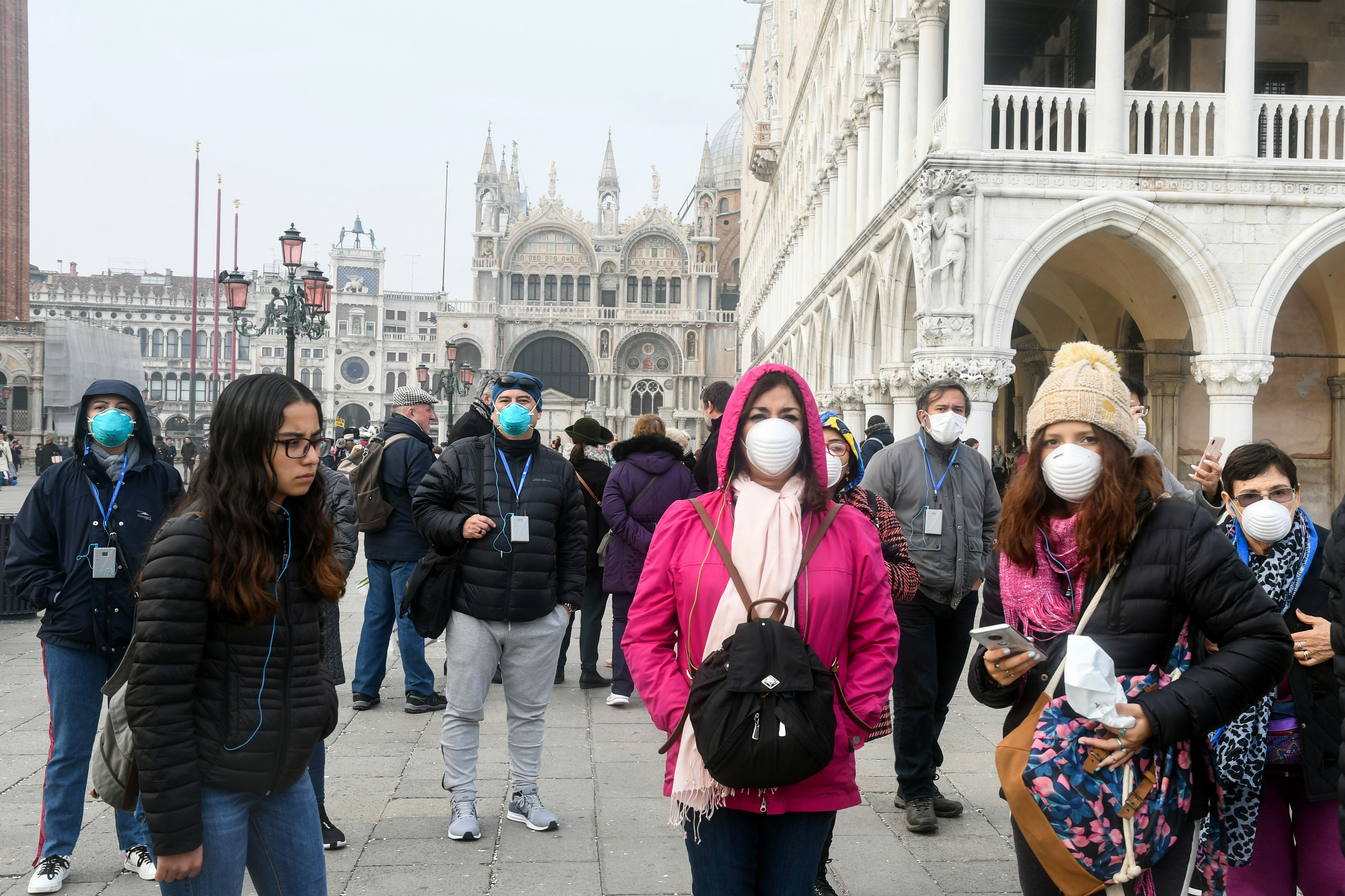 Tourists wearing face masks in Venice, Italy, on February 25.