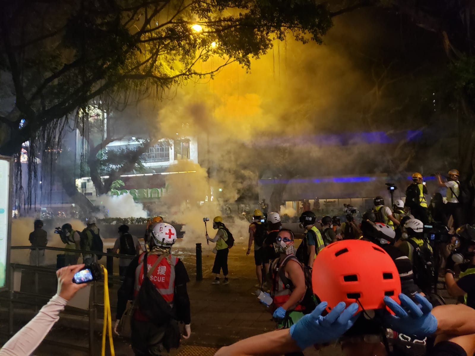 Tear gas is fired for the third time. Ben Westcott/CNN