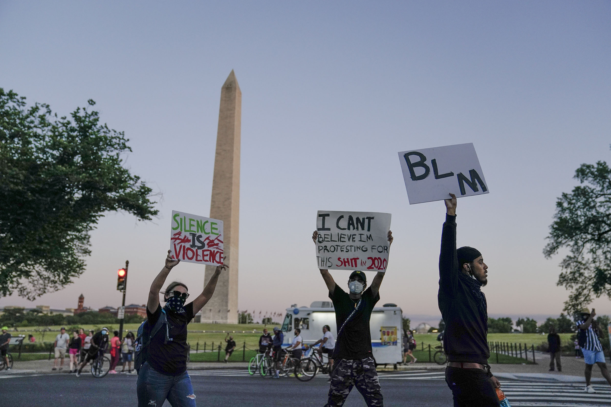 Demonstrators march past the Washington Monument as they protest the death of George Floyd, on Sunday, May 31.