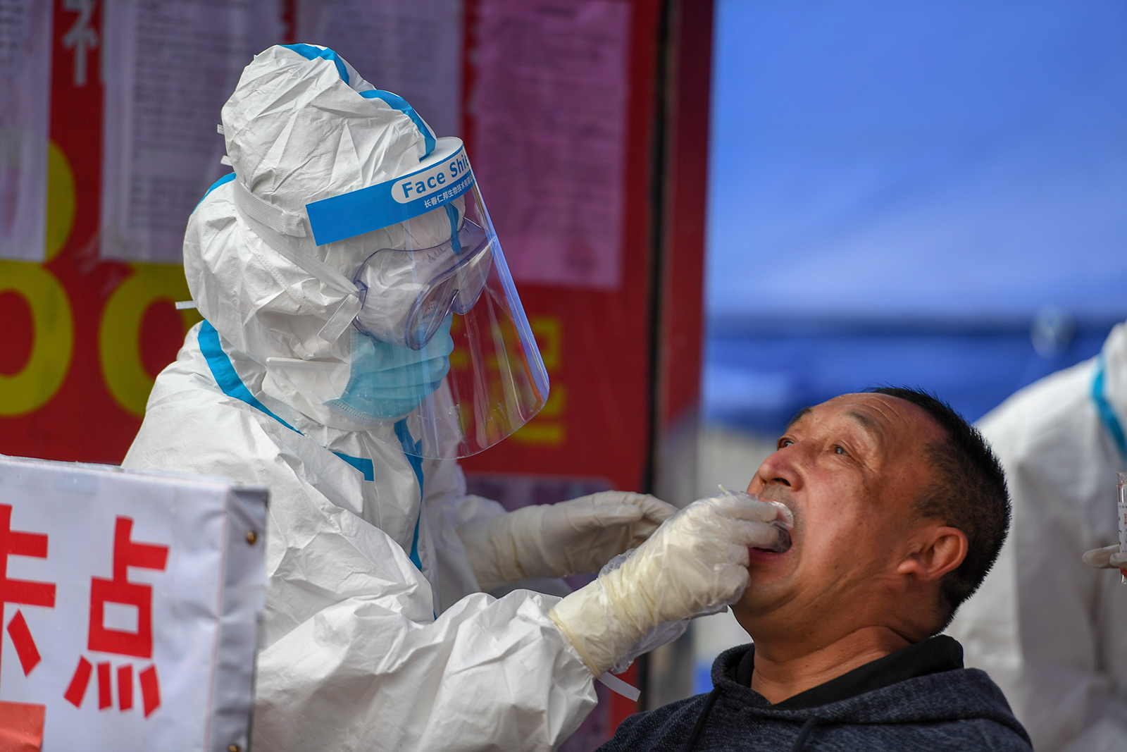 A medical worker collects sample for Covid-19 testing at the Tongji community in Shulan, China on May 17.
