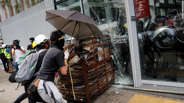 Protesters trying to break into the Legislative Council in Hong Kong.