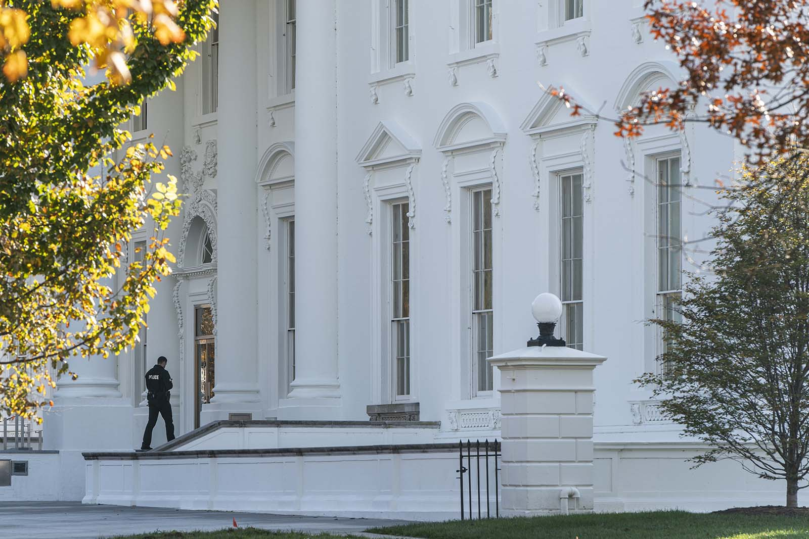 A Secret Service officer patrols at the White House on November 9, in Washington.