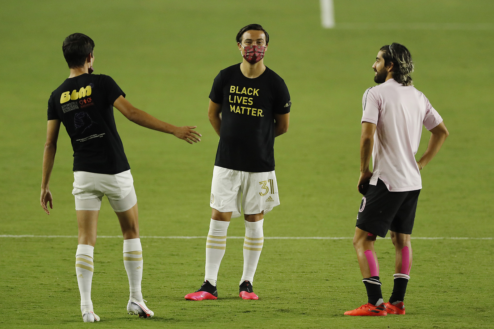 Erick Torres of Atlanta United talks with Rodolfo Pizarro of Inter Miami CF after the game was postponed at Inter Miami CF Stadium on August 26 in Fort Lauderdale, Florida.