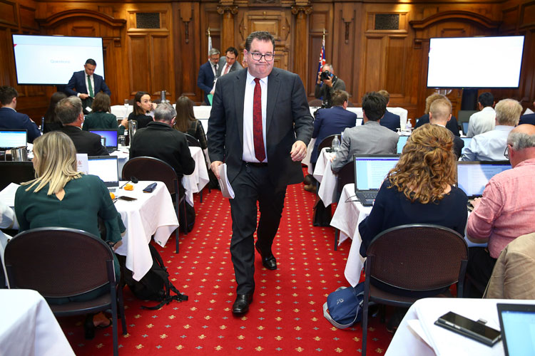 Finance minister Grant Robertson makes an exit at the conclusion of a coronavirus financial response package announcement at Parliament on March 17 in Wellington, New Zealand.