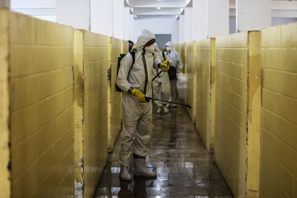 Members of the military perform a cleaning work in Health Clinic Nossa Senhora das Vitórias, in Ze Garoto neighborhood during the coronavirus pandemic on May 13, in Sao Goncalo, Brazil.