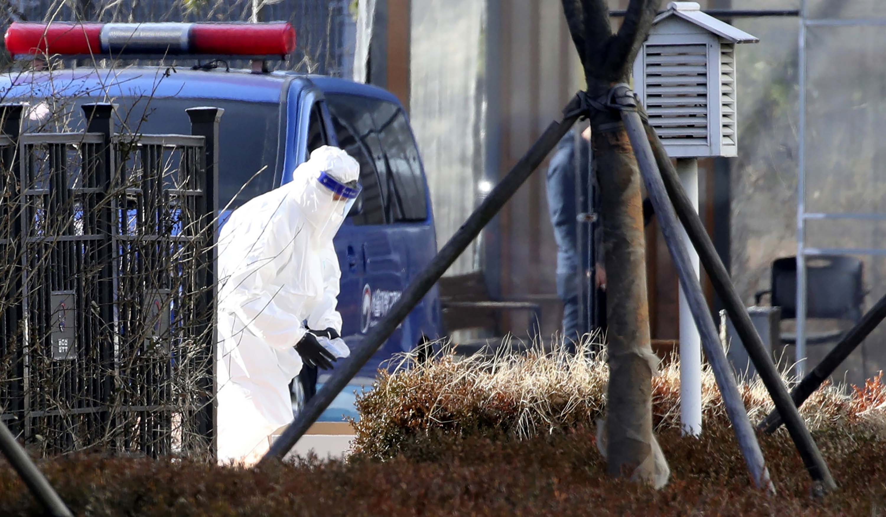 A person wearing protective gear is pictured at Seoul's Dongbu Detention Center in Seoul, South Korea, on December 31, 2020.