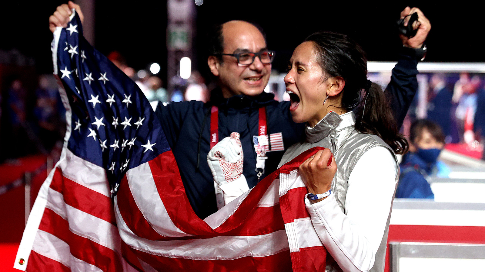 Lee Kiefer of the United States celebrates with her coach after winning gold in fencing against Inna Deriglazova of the Russia Olympic Committee on July 25.