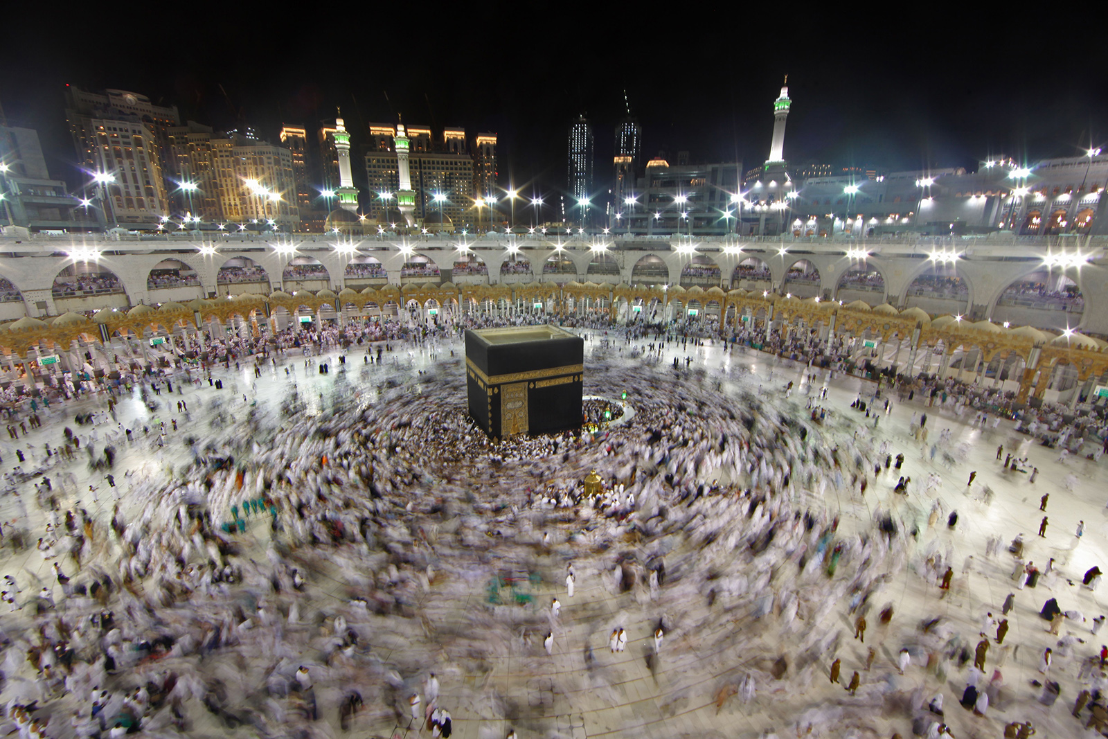 In this June 14, 2018 file photo, Muslim worshippers gather at the Grand Mosque in Islam's holiest city of Mecca as they perform the Umrah, or lesser pilgrimages, during the last week of the month of Ramadan.