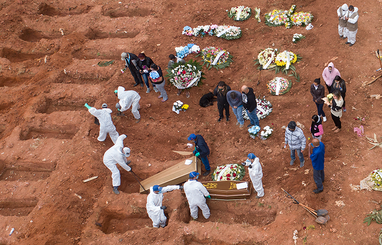 Cemetery workers in protective clothing bury victims of the new coronavirus at the Vila Formosa cemetery in Sao Paulo, Brazil, Wednesday, July 15.