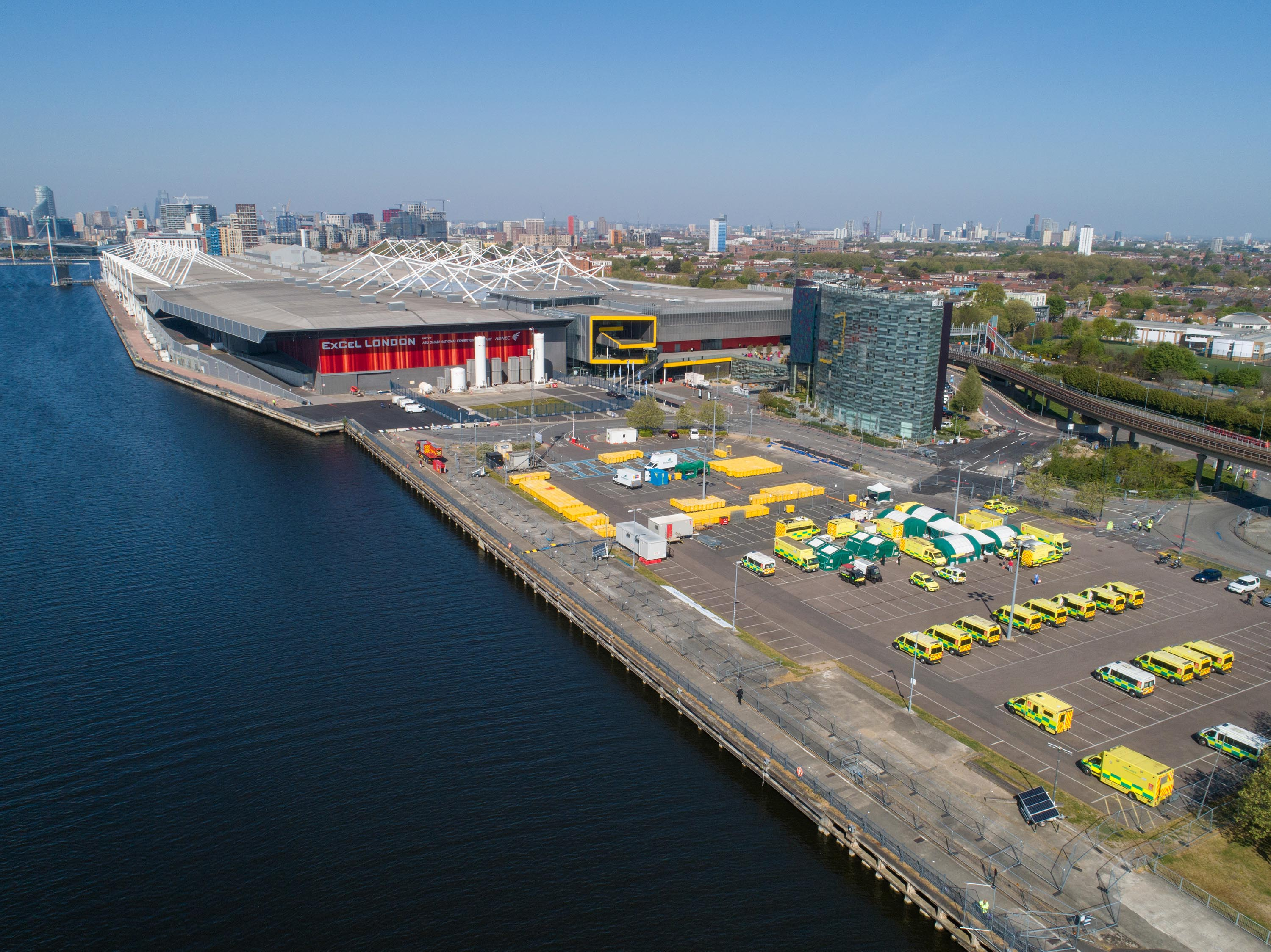 Emergency response vehicles sit parked outside London's ExCel conference center, which has been converted into an NHS Nightingale hospital to deal with the coronavirus pandemic, in this aerial view on Wednesday.