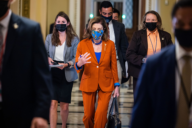 Speaker of the House Nancy Pelosi walks off the House floor following a procedural vote on suspending the debt limit on Wednesday, September 29.