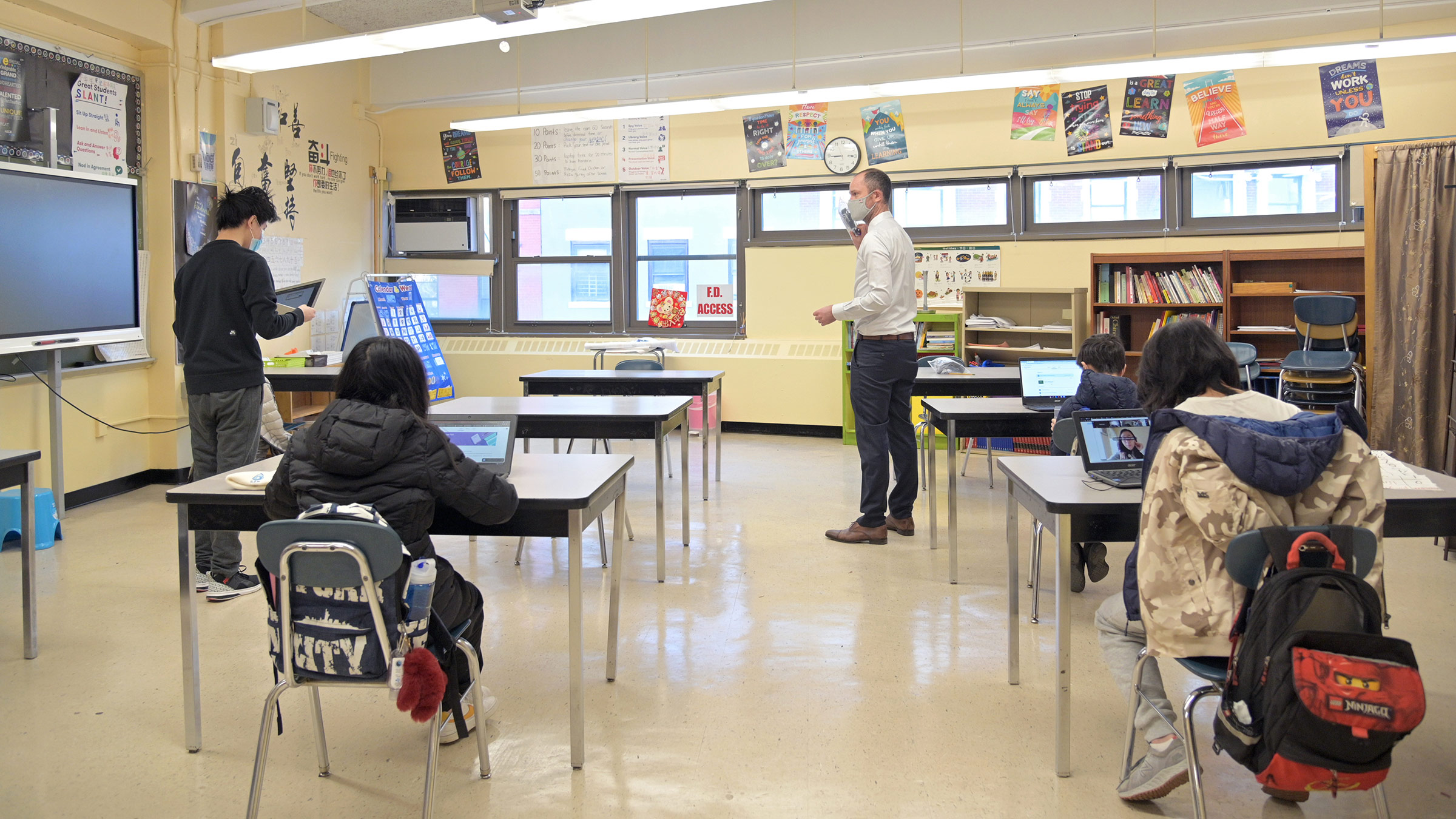 Principal Ben Geballe speaks with students at Sun Yat Sen M.S. 131 on February 25, in New York City.