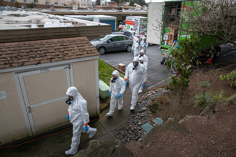 A cleaning crew wearing protective clothing enters the Life Care Center on Thursday, March 12, in Kirkland, Washington. The nursing home in the Seattle suburbs has had the most deaths due to COVID-19 of anywhere in the United States.