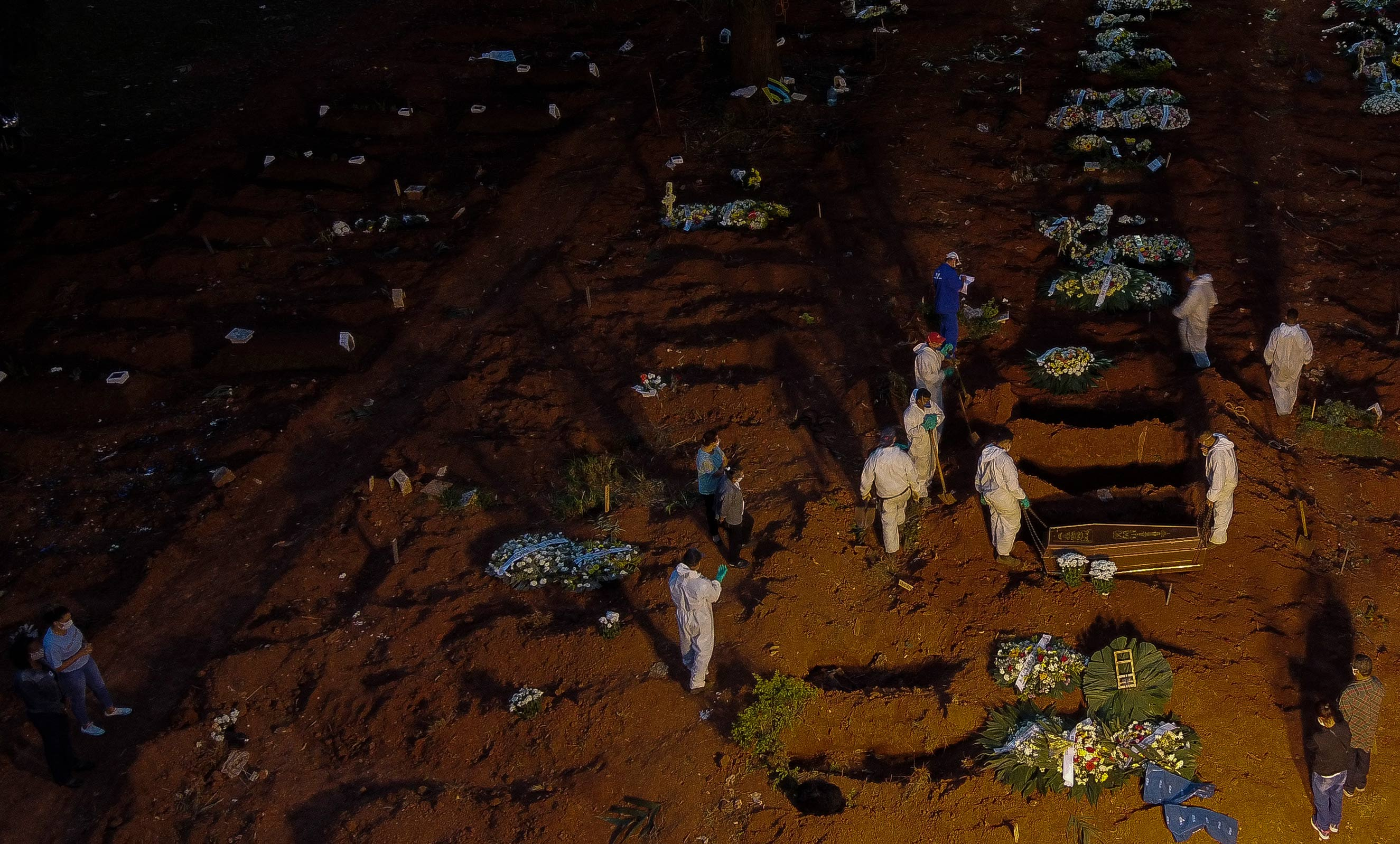 Workers bury a coffin at the Vila Formosa cemetery in Sao Paulo, Brazil, on April 17.
