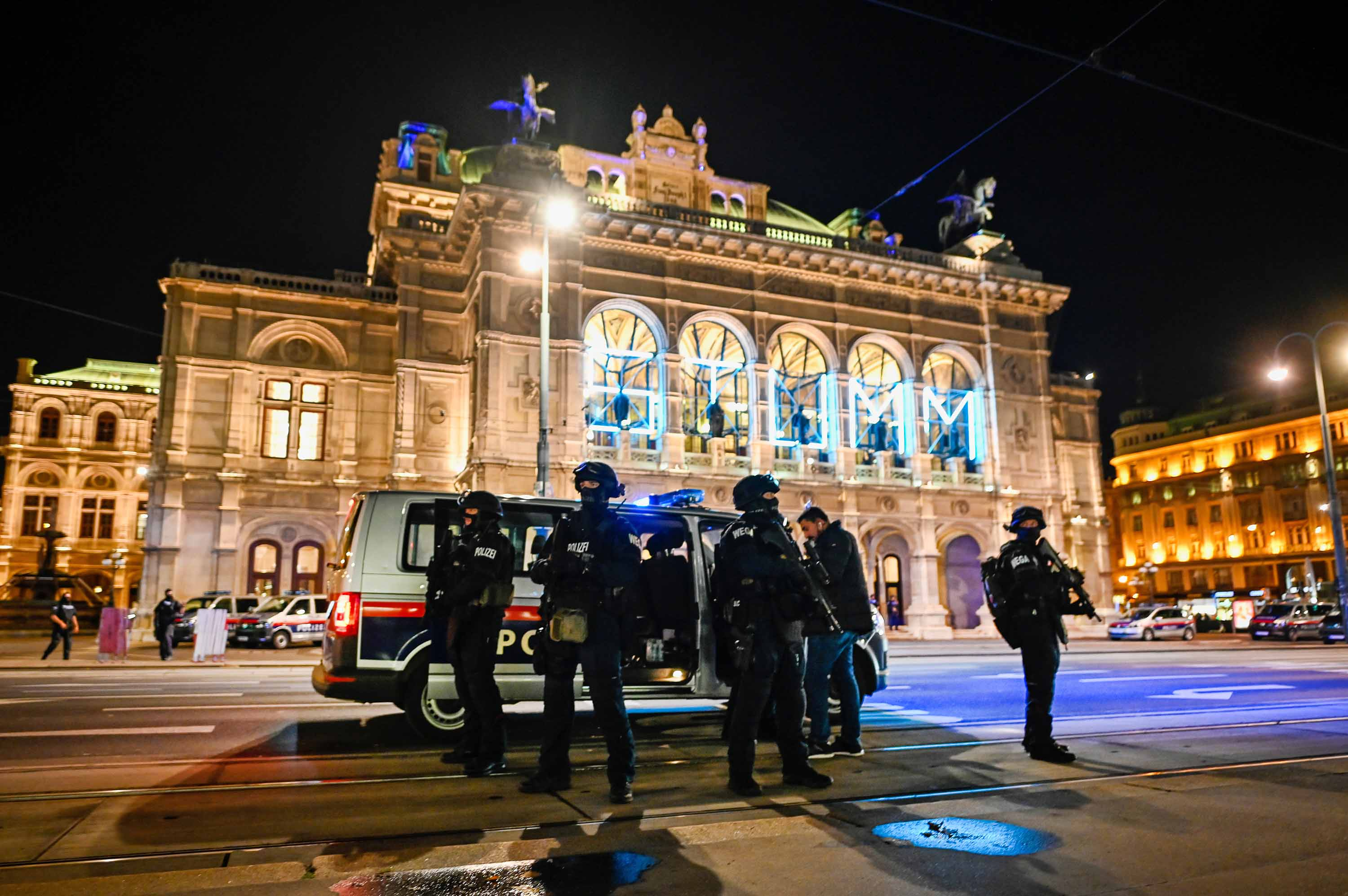 Heavily armed police stand outside the Vienna State Opera after shots were fired in the city center on Monday night.