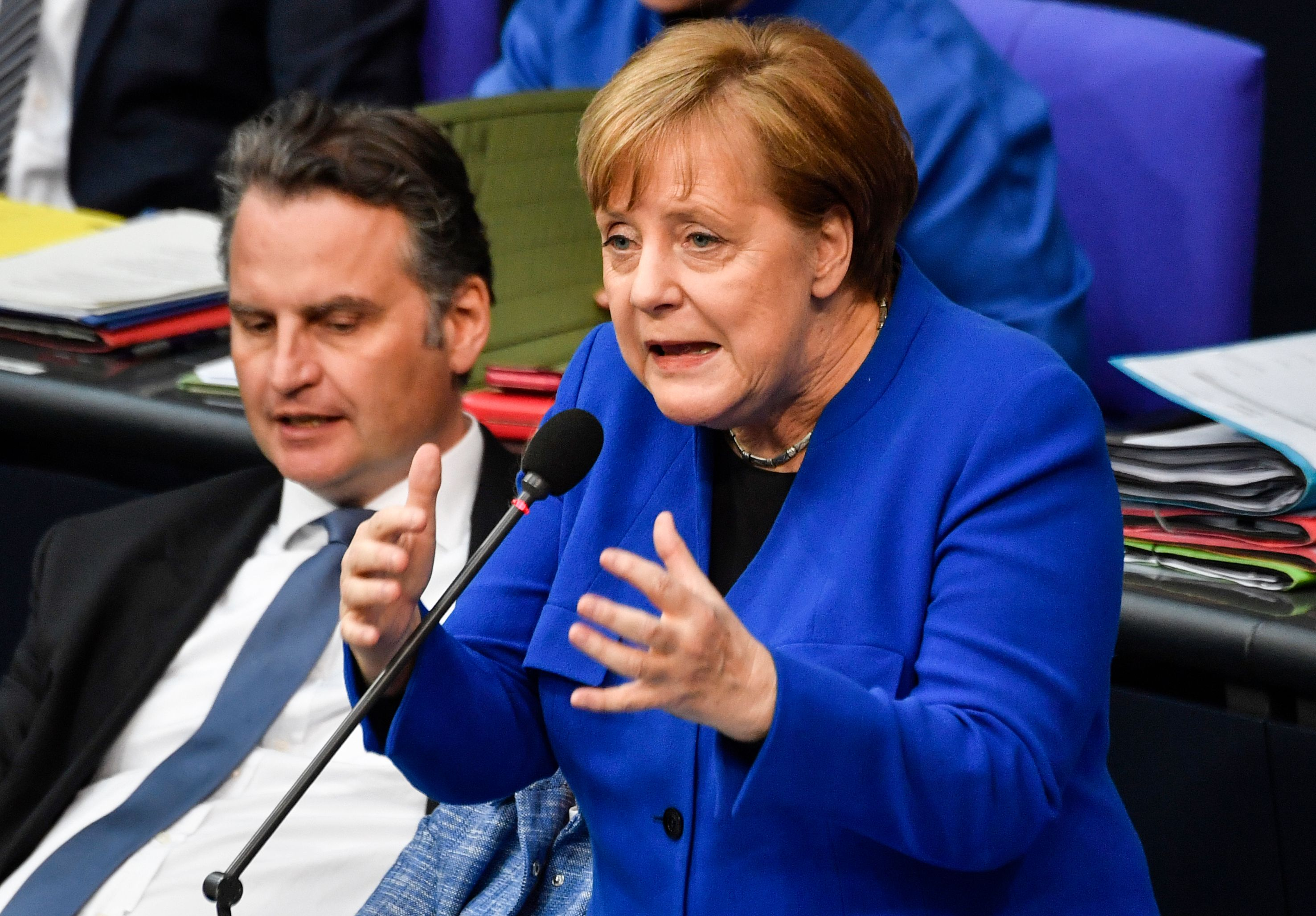German Chancellor Angela Merkel speaks during question time at the Bundestag, the lower house of Germany's parliament, in Berlin on Wednesday.